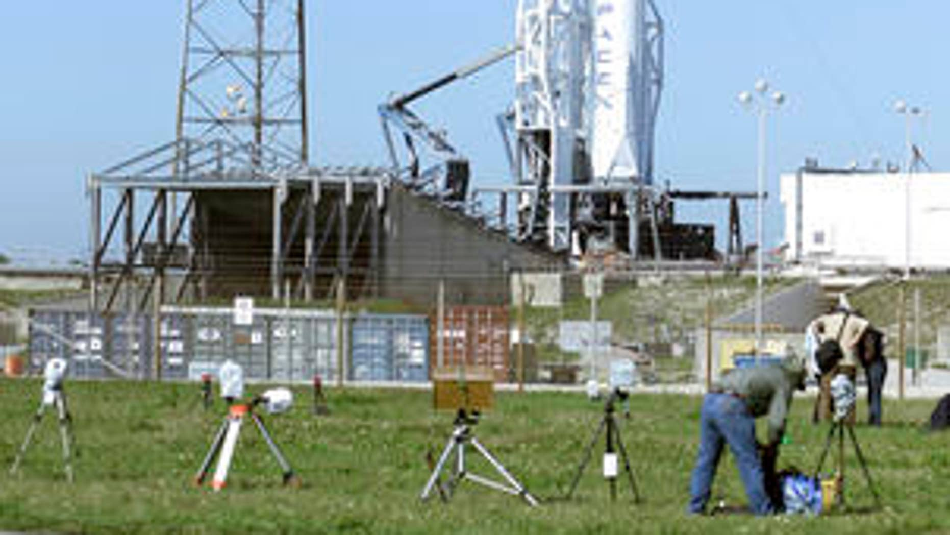 The SpaceX Falcon 9 rocket stands ready for launch at the Kennedy Space Center in Cape Canaveral, Fla., Friday, April 8, 2016. The rocket, scheduled for launch later today, is set to deliver almost 7,000 pounds of science research, crew supplies, and hardware to the International Space Station. (AP Photo/John Raoux)