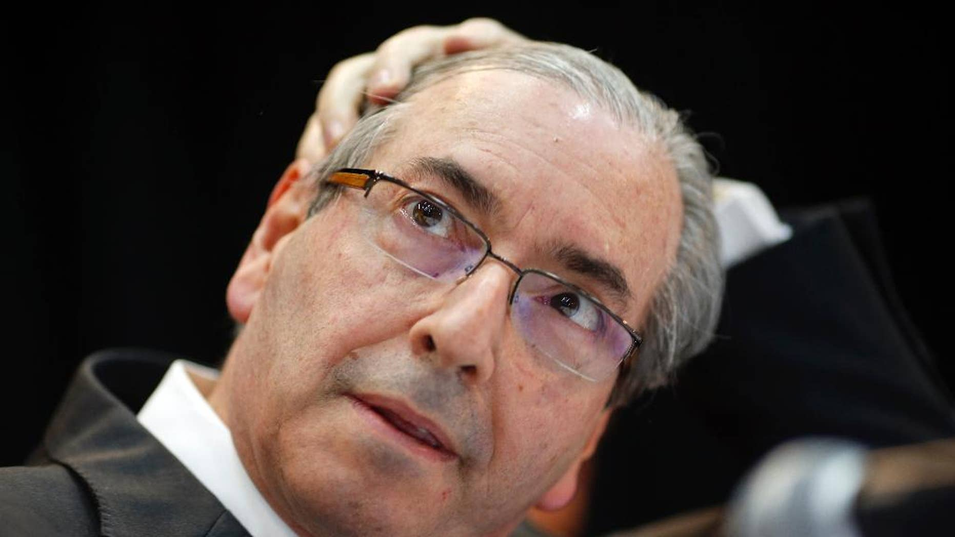 FILE - In this Aug.21, 2015 file photo, Eduardo Cunha, president of Brazil's Chamber of Deputies, attends a meeting with union workers in Sao Paulo, Brazil. Brazil's Supreme Court seized $2.45 million in Swiss accounts allegedly belonging to Cunha, a powerful political figure who can largely determine whether widely sought impeachment proceedings against President Dilma Rousseff are introduced on the chamber floor. Cunha is facing corruption charges in a huge kickback scheme at state-run oil company Petrobras. (AP Photo/Andre Penner, File)