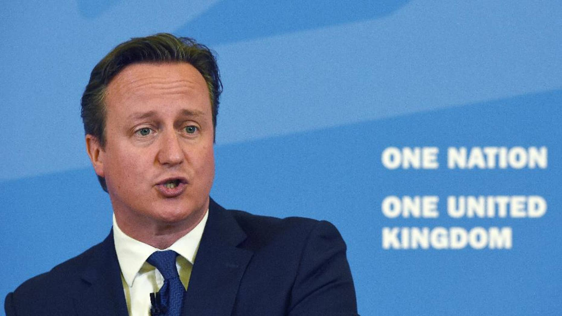 """Britain's Prime Minister David Cameron delivers a speech, where he said that new Government legislation will include powers to put non-violent extremists who radicalize young people """"out of action"""", at Ninestiles Academy in Birmingham, England, Monday, July 20, 2015. Cameron is launching a five-year plan to defeat Islamic extremism, saying it's time to counter the ideology that has attracted so many young people to the Islamic State group. In what is being billed as his most important speech on the subject, Cameron says the extremist ideology of the group, also known as ISIL, must be countered so Britain becomes a more cohesive nation in which young Muslims feel they have a stake. (Paul Ellis/PA via AP)     UNITED KINGDOM OUT      -    NO SALES     -    NO ARCHIVES"""