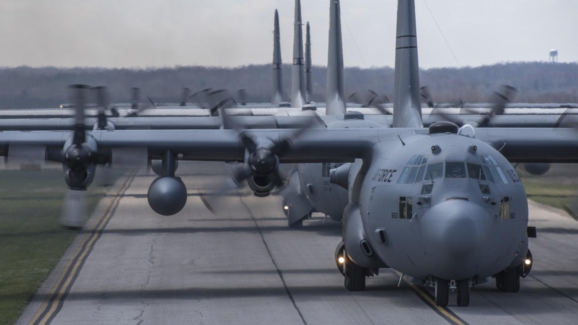 File photo - The 179th Airlift Wing conducts a five ship formation flight using five of their eight C-130H Hercules to conduct coordinated airdrops, April 26, 2018. As the unit's first five ship formation since the conversion back to the C-130H, the flight allowed members of maintenance, aerial port and operations groups to work together increasing overall readiness of deployable assets. (U.S. Air National Guard photo by Tech. Sgt. Joe Harwood/RELEASED)