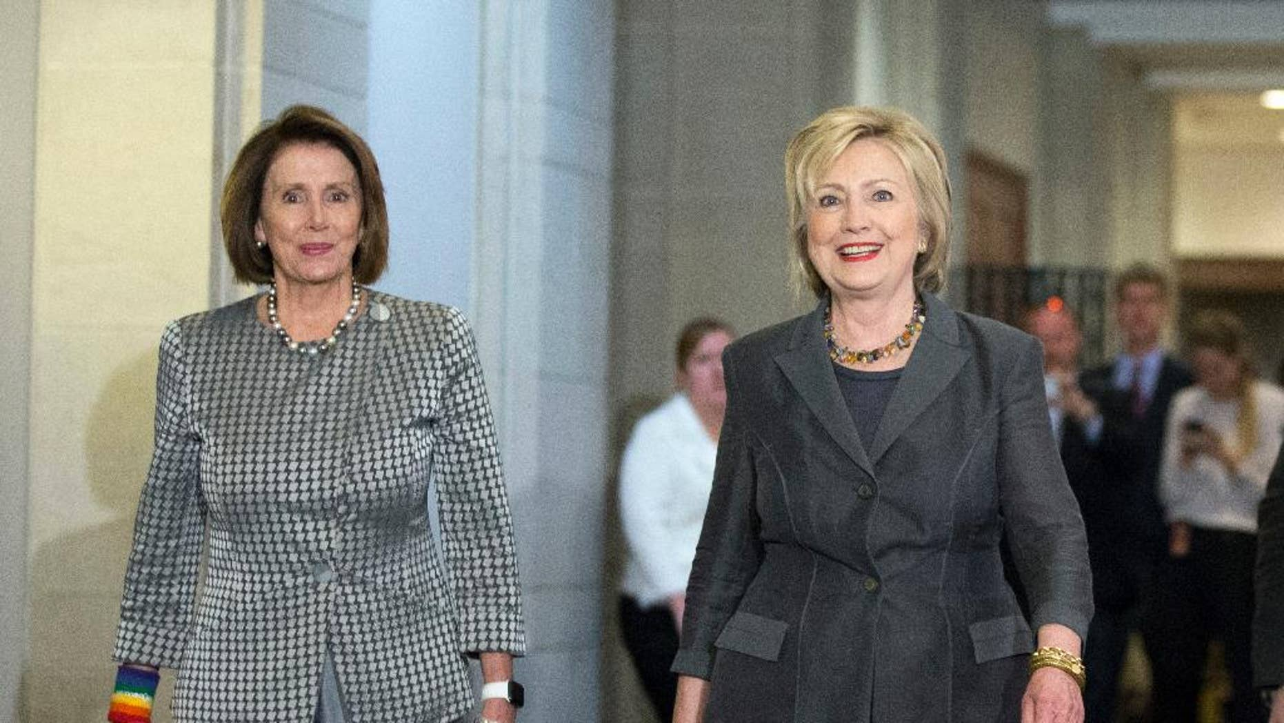 Then-Democratic presidential candidate Hillary Clinton walks with House Minority Leader Nancy Pelosi of Calif. as they arrive for a meeting with the House Democratic Caucus, Wednesday, June 22, 2016, on Capitol Hill in Washington. (AP Photo/Alex Brandon)