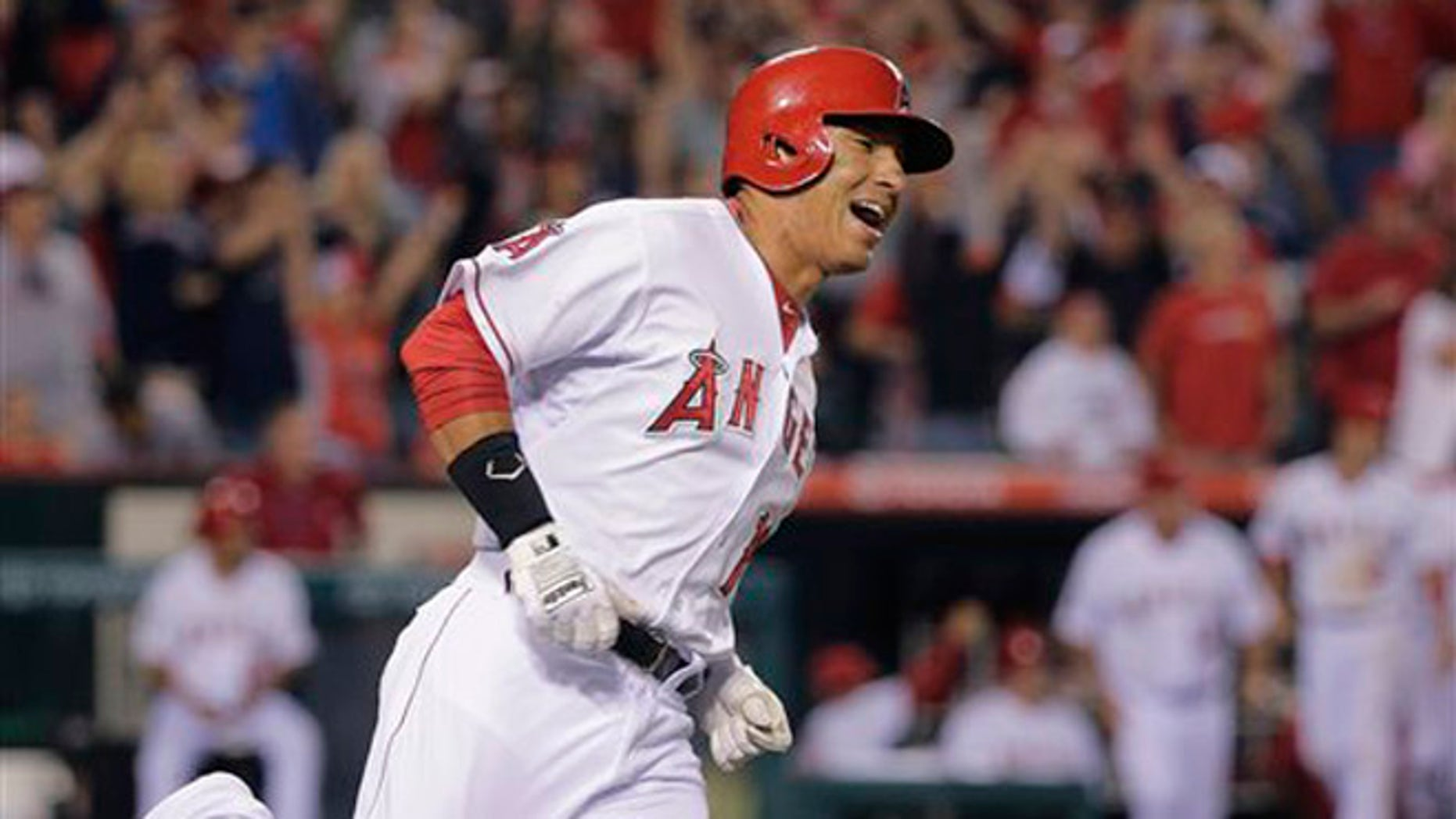 Los Angeles Angels' Efren Navarro celebrates his walk-off double during the 16th inning of a baseball game against the Seattle Mariners on Saturday, July 19, 2014, in Anaheim, Calif. The Angels won 3-2. (AP Photo/Jae C. Hong)