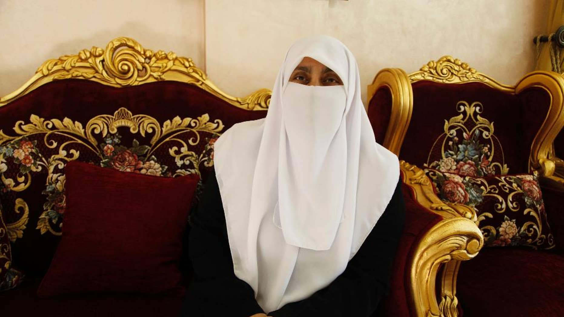 High school principal Huda Etoum poses for a portrait at her home in Jerash, Jordan, Thursday, Sept. 22, 2016. Etoum was one of 20 women elected to Jordan's 130-seat parliament this week, up from 18 female lawmakers in the outgoing legislature. Etoum, the second Jordanian lawmaker wearing a face veil, said in an interview that she's been in public service for more than two decades and that her ultra-conservative dress won't be an obstacle in parliament. (AP Photo/Sam McNeil)