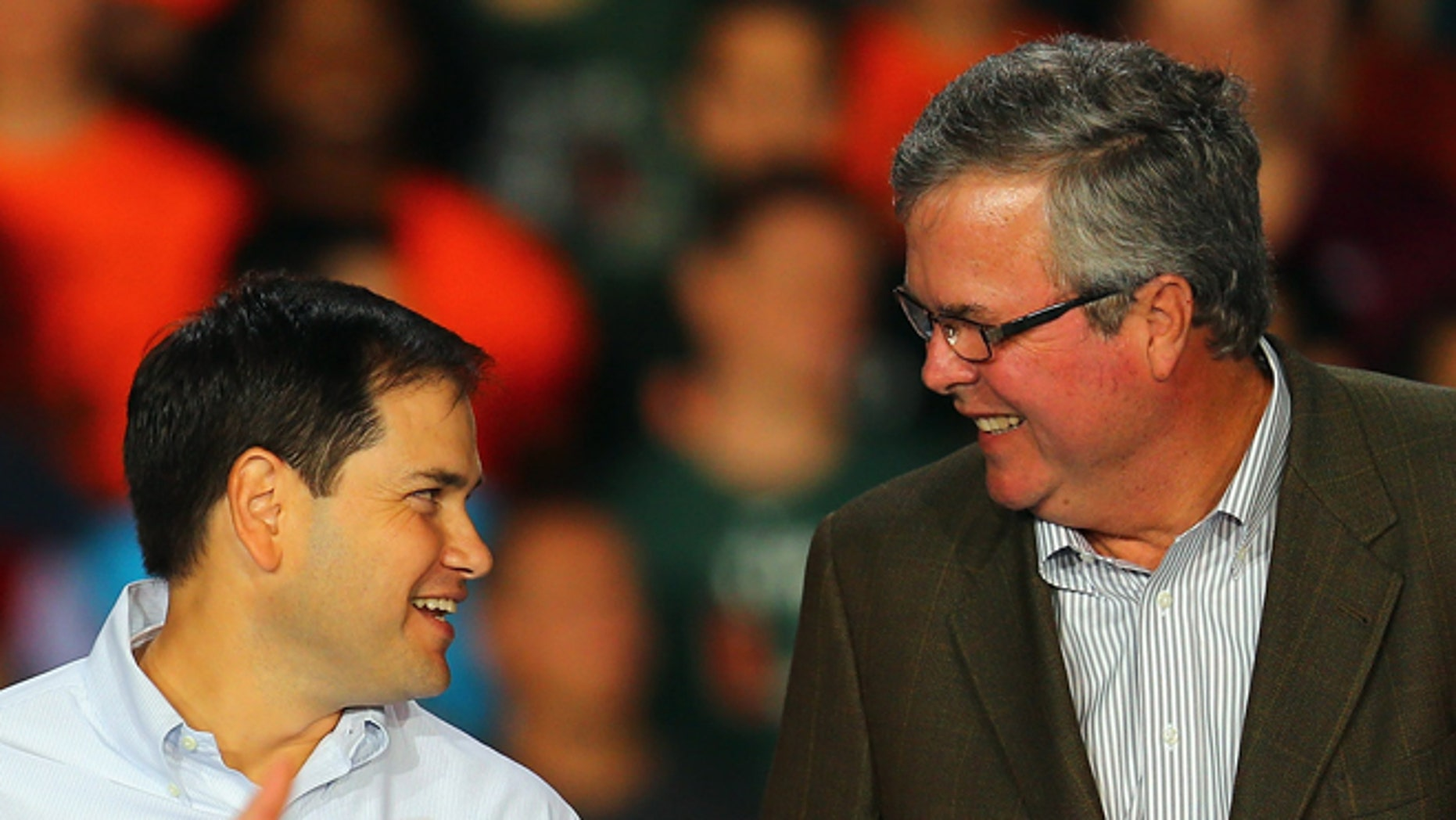 MIAMI, FL - OCTOBER 31:  Republican presidential candidate, former Massachusetts Gov. Mitt Romney speaks as Sen. Marco Rubio (R-FL) (C) and former Florida Gov. Jeb Bush stand next to him during a campaign rally at the BankUnited Center on the campus of the University of Miami on October 31, 2012 in Miami, Florida. In the wake of Hurricane Sandy which hit the northeastern part of the United States, Romney is back to campaigning before the general election on November 6.  (Photo by Joe Raedle/Getty Images)