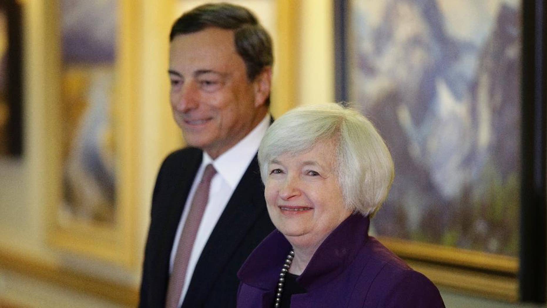 FILE - In this Aug. 22, 2014 file photo, Federal Reserve Chair Janet Yellen, right, and European Central Bank President Mario Draghi walk together during the Jackson Hole Economic Policy Symposium at the Jackson Lake Lodge in Grand Teton National Park near Jackson, Wyo. Record low interest rates were meant to be a temporary response to the global financial crisis. But eight years later, rates are still near zero in much of the developed world - and some experts are warning of long-term side effects. The Federal Reserve lowered its short-term benchmark - which determines the cost of overnight lending between banks - to between zero and 0.25 percent in December 2008. The European Central Bank reached zero in March and the Bank of Japan in late 2010. Just last week, the Bank of England cut its benchmark rate to 0.25 percent and indicated it could bring it closer to zero. (AP Photo/John Locher, file)