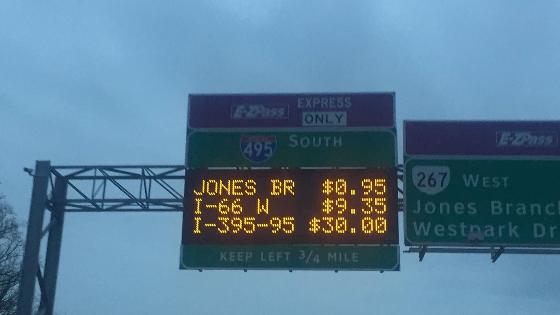 A sign laying out the tolls on Thursday.