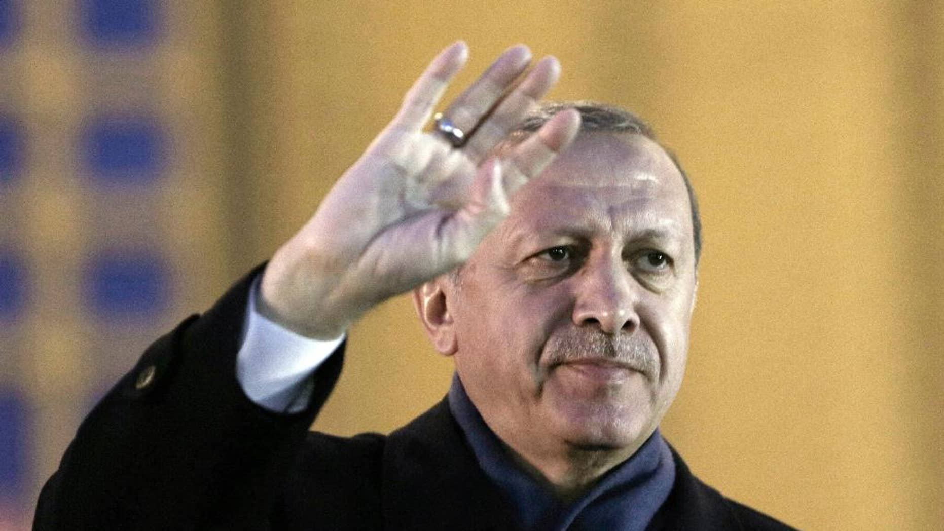 Turkey's President Recep Tayyip Erdogan gestures as he delivers a speech during a rally of supporters a day after the referendum, at his palace, in Ankara, Turkey, Monday, April 17, 2017. Turkey's main opposition party urged the country's electoral board Monday to cancel the results of a landmark referendum that granted sweeping new powers to Erdogan, citing what it called substantial voting irregularities. (AP Photo/Burhan Ozbilici)