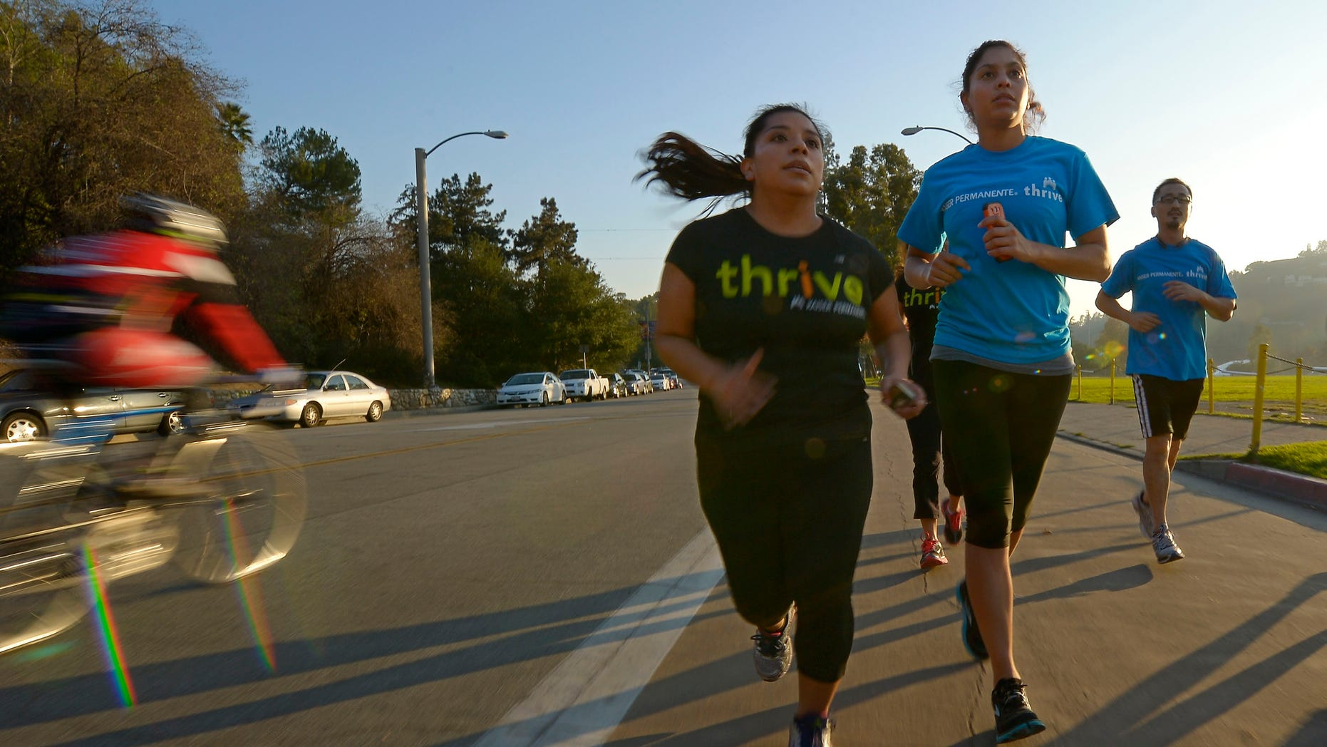Dec. 11, 2012: In this photo, Zendi Solano, center, trains with running club members Rian Barrett, second from right, and Richard Chen in Pasadena, Calif.