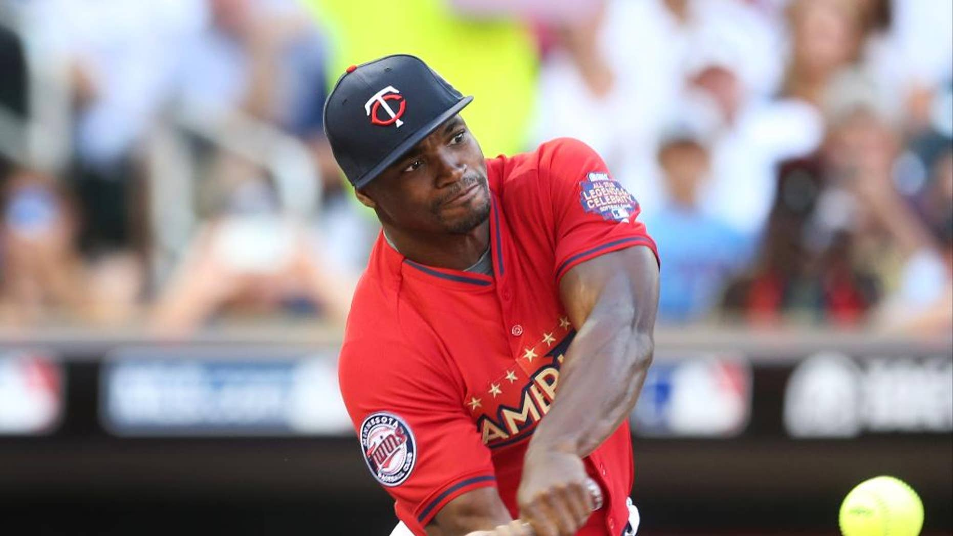 Minnesota Vikings running back Adrian Peterson bats during the All-Star Legends & Celebrity Softball Game, Sunday, July 13, 2014, in Minneapolis. (AP Photo/Jim Mone)