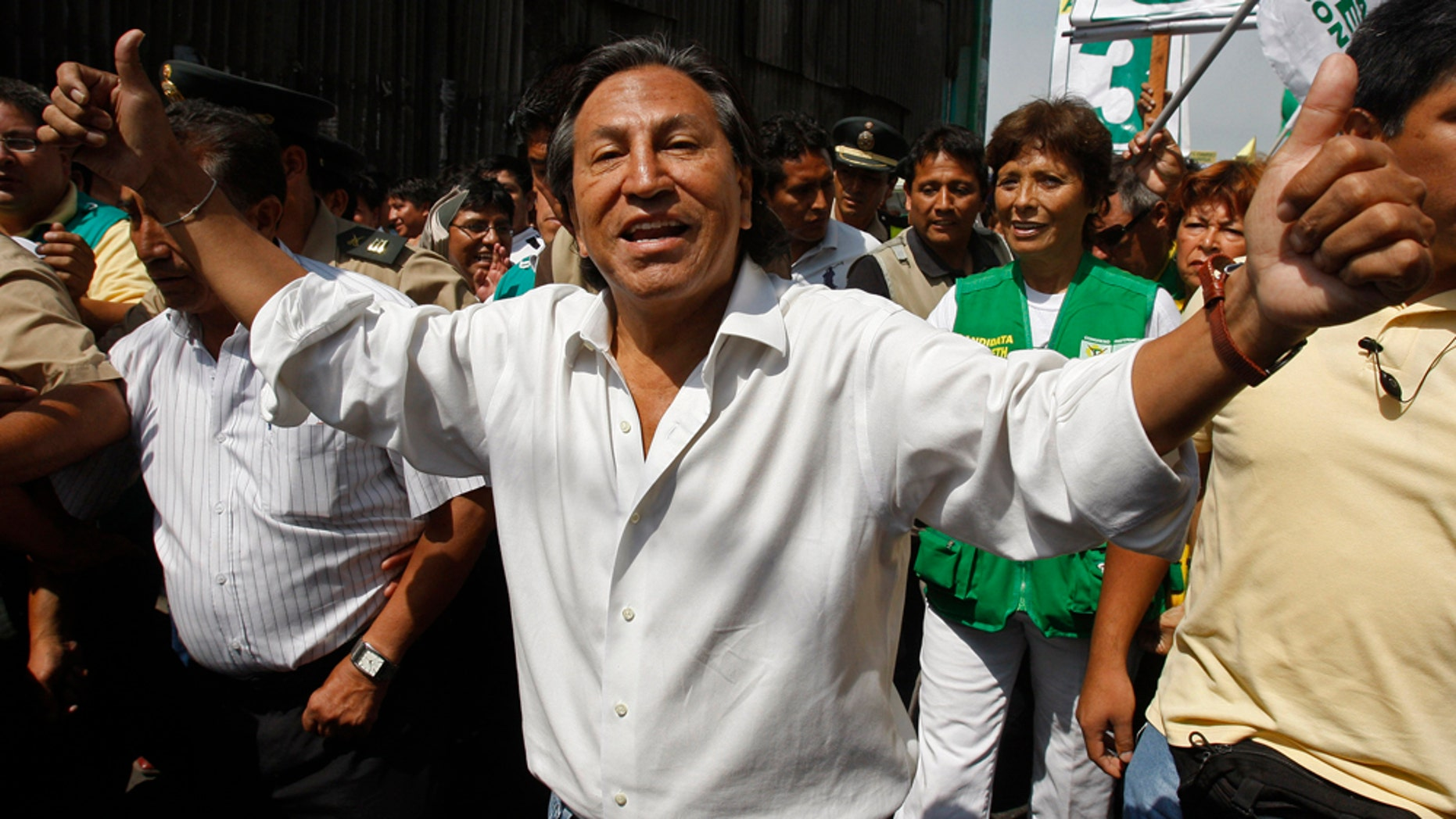 Peru's former President Alejandro Toledo campaigns for reelection at the Santa Anita wholesale market in Lima, Peru, Thursday March 17, 2011. Peru will hold general elections on April 10. (AP Photo/Karel Navarro)