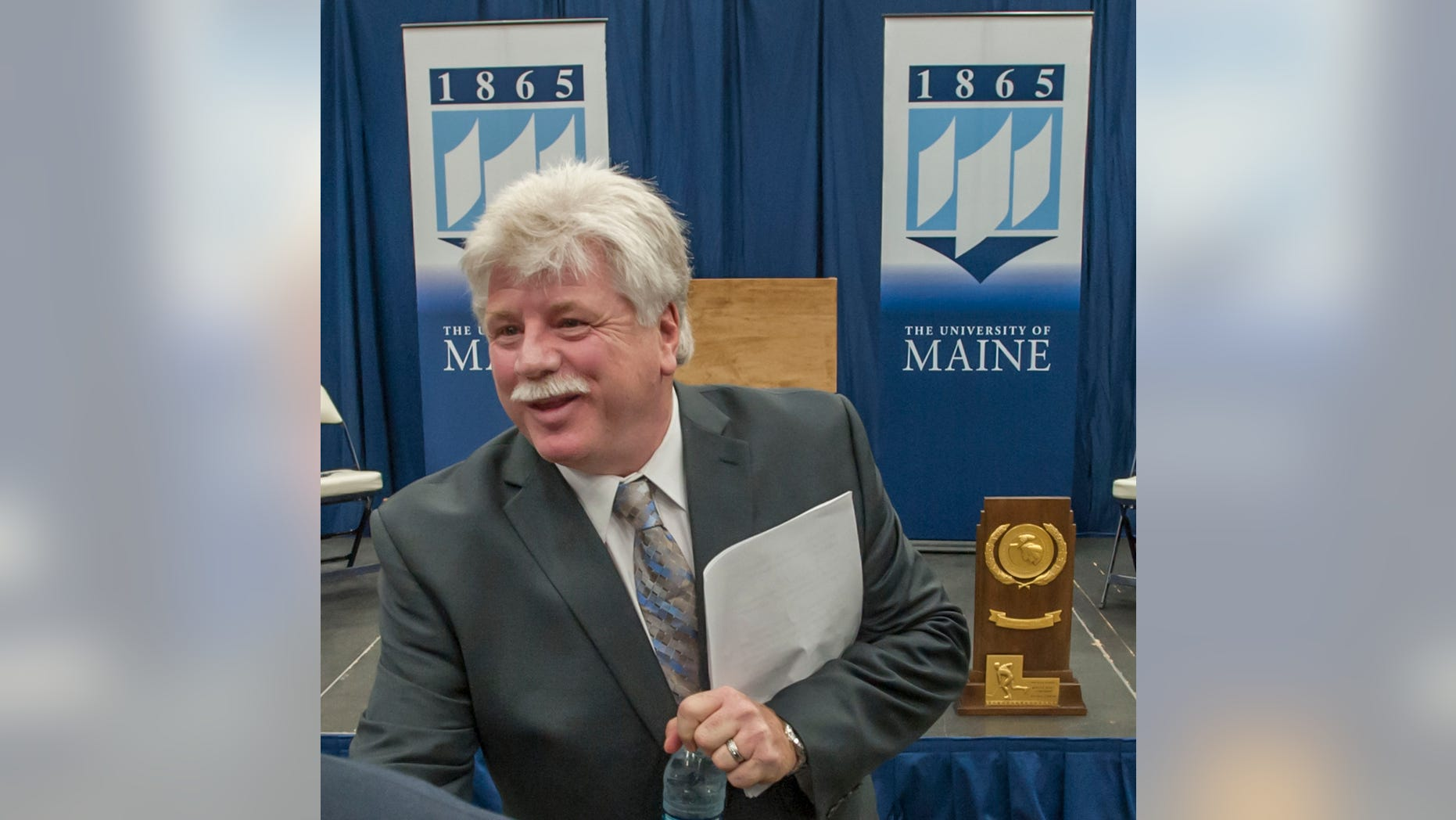 "FILE - In this May 28, 2013 file photo, Dennis ""Red"" Gendron  speaks to well-wishers after being introduced as the new men's hockey coach at the University of Maine, in Orono, Maine. Gendron has coached championship hockey teams in high school, college and the NHL. The hockey faithful are hoping he can now restore the luster to the University of Maine hockey program. (AP Photo/Michael C. York, File)"
