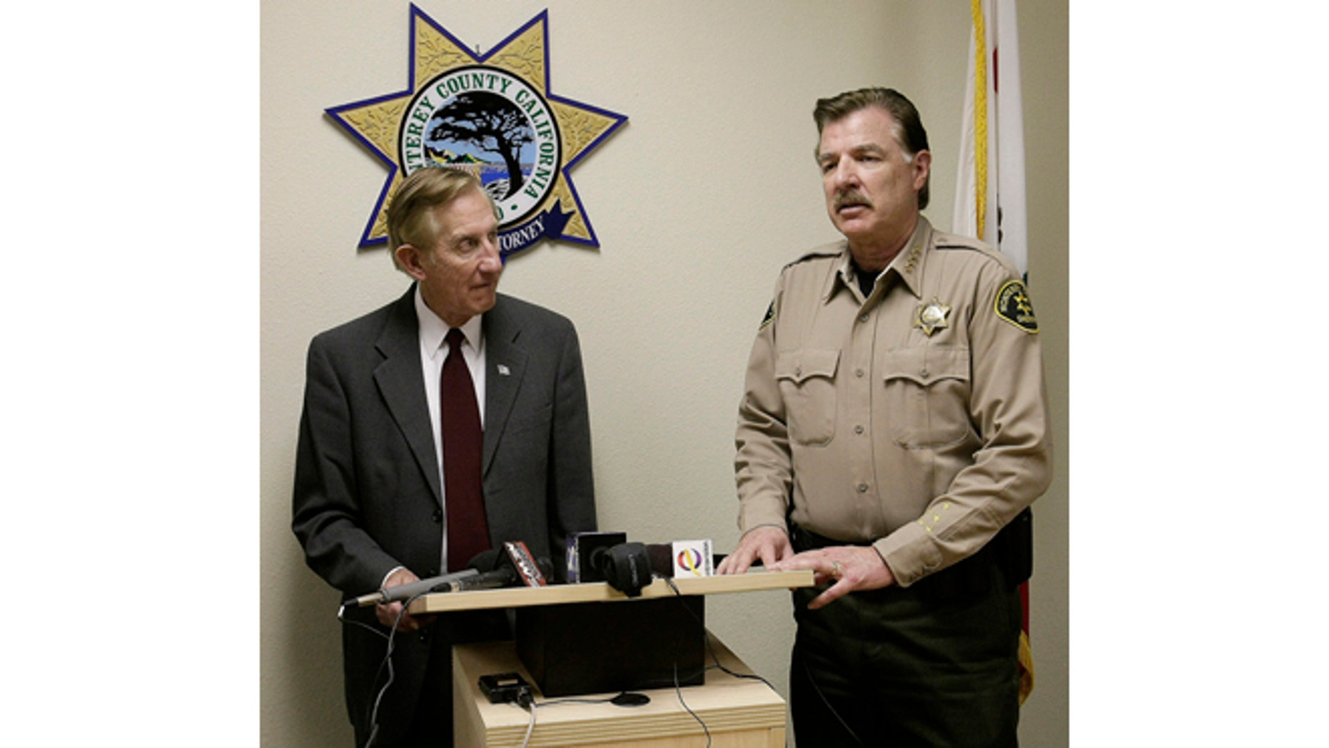 Monterey County District attorney Dean Flippo, left, and Monterey County Sheriff Scott Miller answer questions during a news conference, Tuesday, Feb. 25, 2014, in Salinas, Calif. Flippo said the six officers, including the recently retired police chief and the acting chief, have been arrested, in connection to a scheme to steal more than 200 cars from poor Hispanic people. (AP Photo/The Monterey County Herald, Vern Fisher)