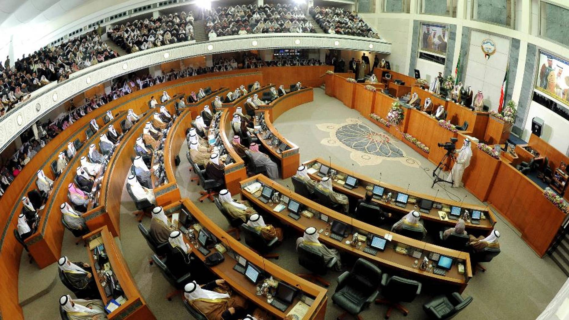 """FILE - This Dec. 16, 2012 file photo shows a General view of Kuwait's National Assembly during the inauguration of the 14th Legislative Term of the National Assembly in Kuwait. Kuwait's Cabinet has resigned and its parliament was dissolved Sunday, Oct. 16, 2016, over a """"lack of cooperation,"""" setting the stage for early elections. Kuwait's state-run television and news agency made the announcement after an emergency government meeting. In a decree, Kuwait's ruling emir Sheikh Sabah Al Ahmad Al Sabah said """"given the circumstances in the region ... and the security challenges"""" he had ordered the parliament dissolved. (AP Photo/Gustavo Ferrari, File)"""