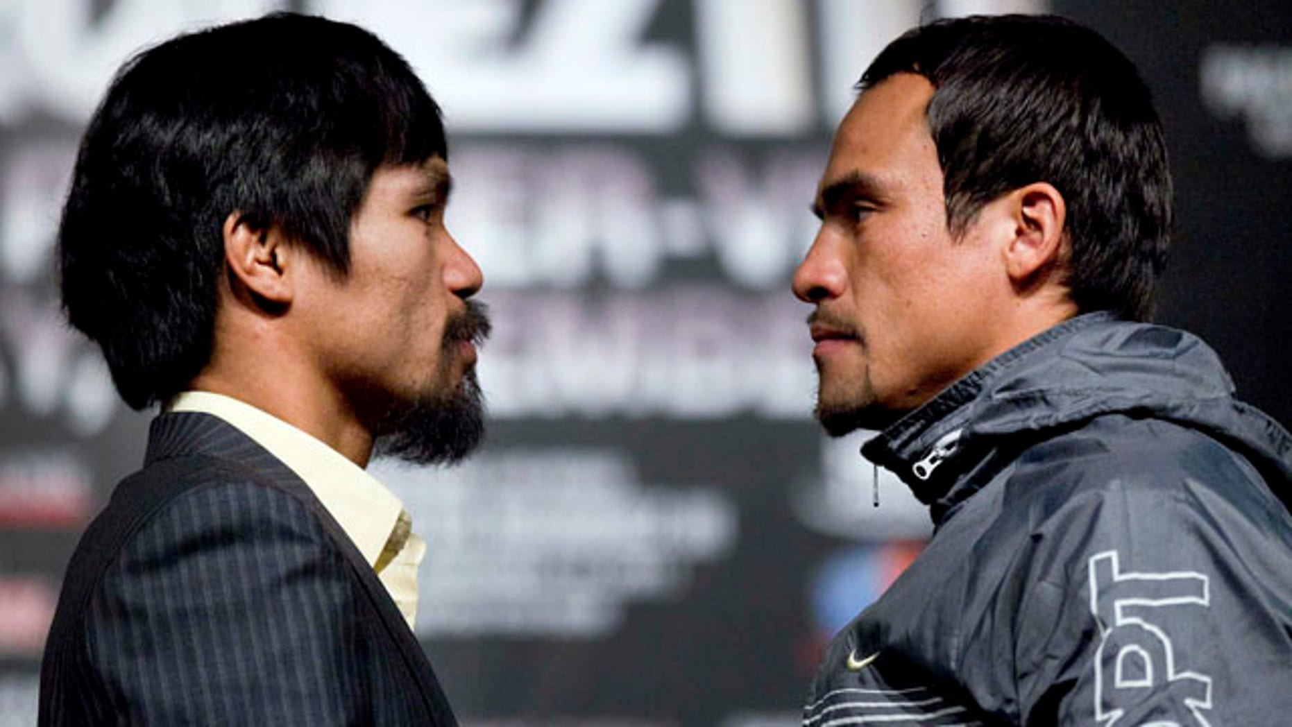 Manny Pacquiao, left, poses for photos with Juan Manuel Marquez during a news conference, Wednesday, Nov. 9, 2011, in Las Vegas. Pacquiao and Marquez will battle for the WBO welterweight championship on Saturday. (AP Photo/Julie Jacobson)