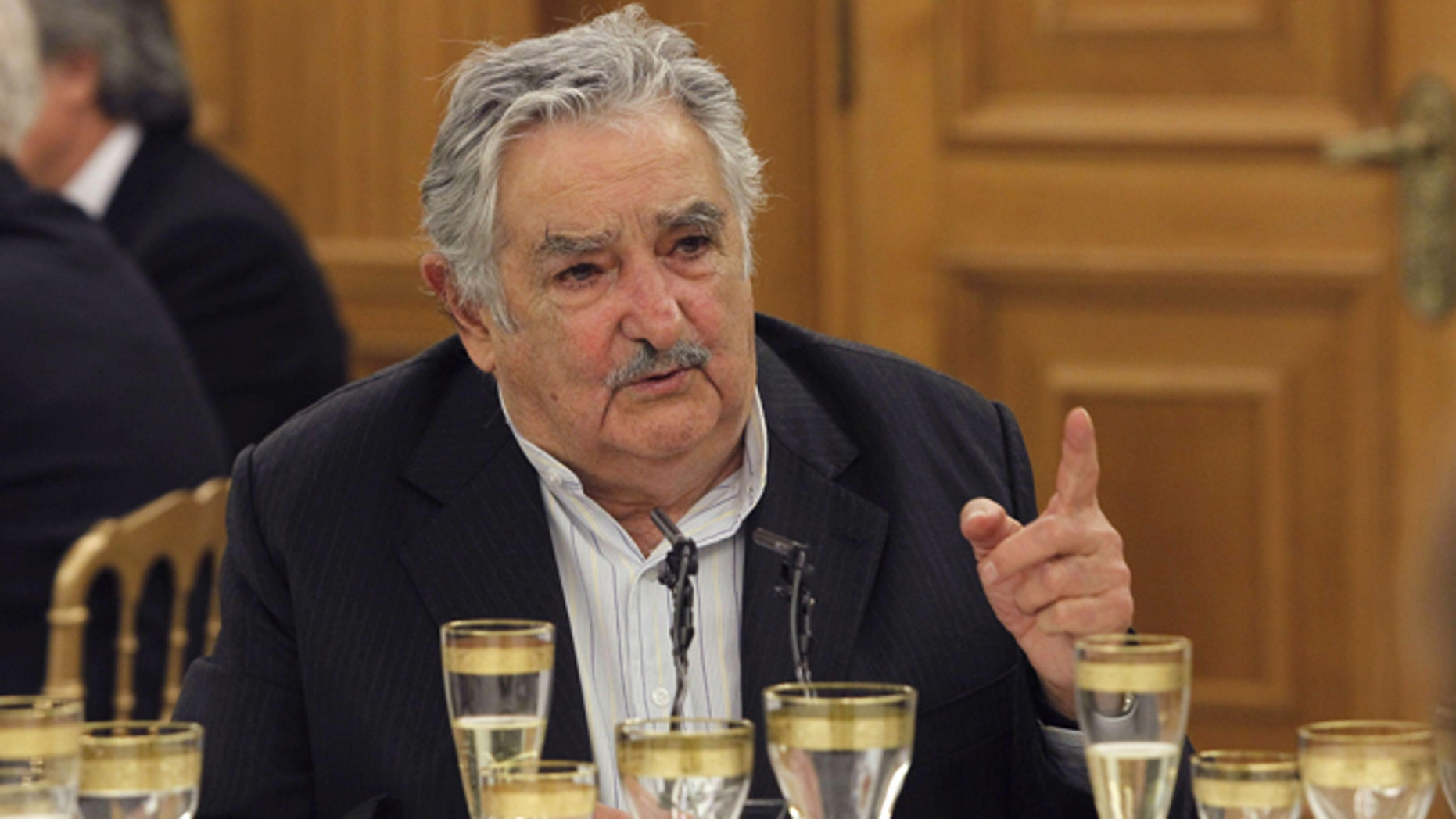 MADRID, SPAIN - MAY 29:  President of Uruguay Jose Mujica attends a dinner hosted by King Juan Carlos I of Spain (not pictured) at Zarzuela Palace on May 29, 2013 in Madrid, Spain. Uruguay's President Jose Mujica is visiting Spain as part of an official tour to China, Spain, Italy and Vatican.  (Photo by Alberto Martin - Pool/Getty Images)