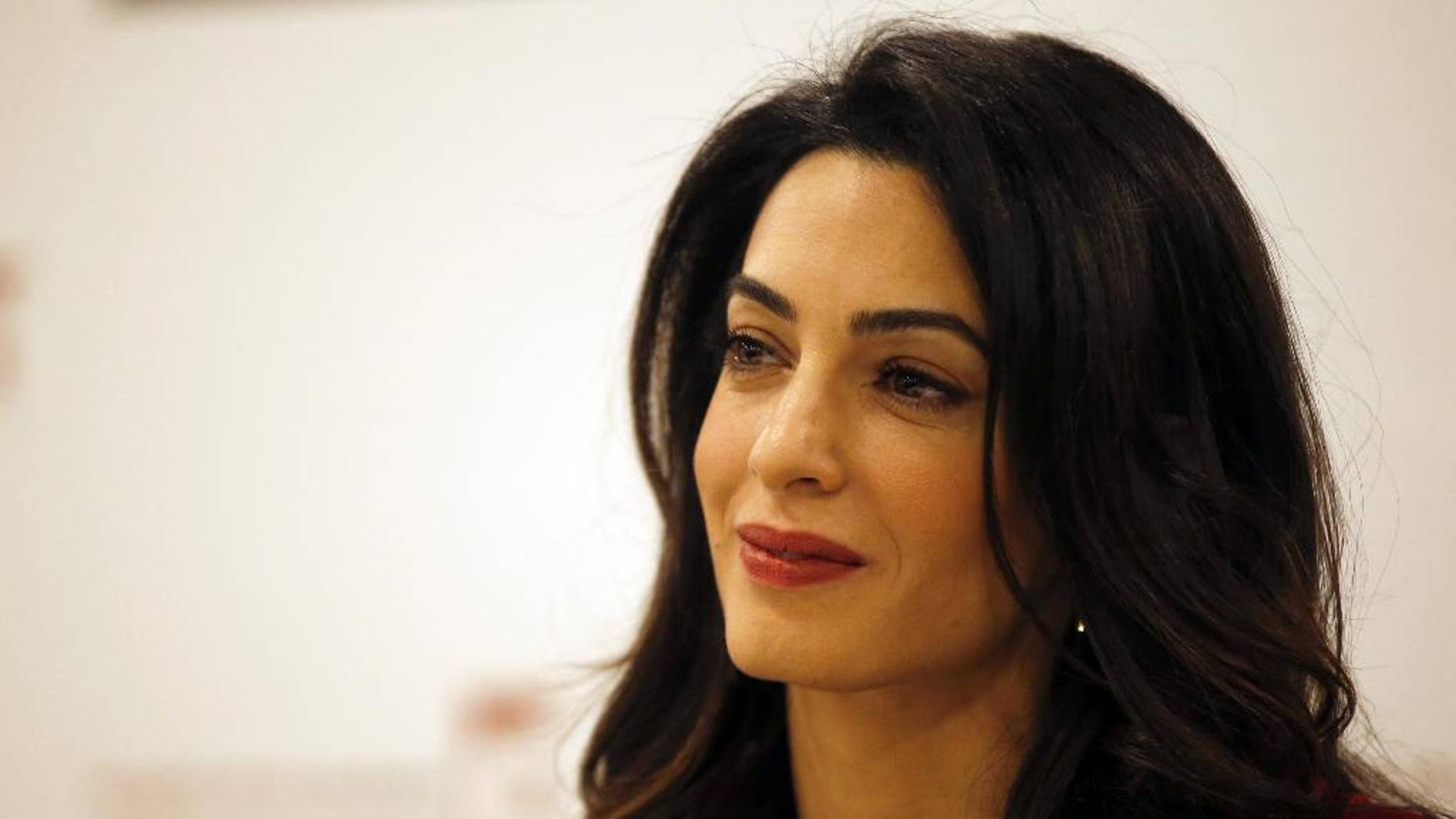 "FILE - In this Jan. 25, 2016, file photo, British lawyer Amal Clooney attends a press conference with former Maldives president Mohamed Nasheed in London. Clooney  is pushing for the United Nations to investigate and prosecute Islamic State commanders for genocide. Clooney wants IS leaders tried over the killings. The British lawyer appeared on NBC's ""Today"" show in an interview broadcast Monday, Sept. 19, 2016, alongside 23-year-old Nadia Murad, a Yazidi woman who escaped after being captured by IS in 2014. (AP Photo/Alastair Grant, File)"
