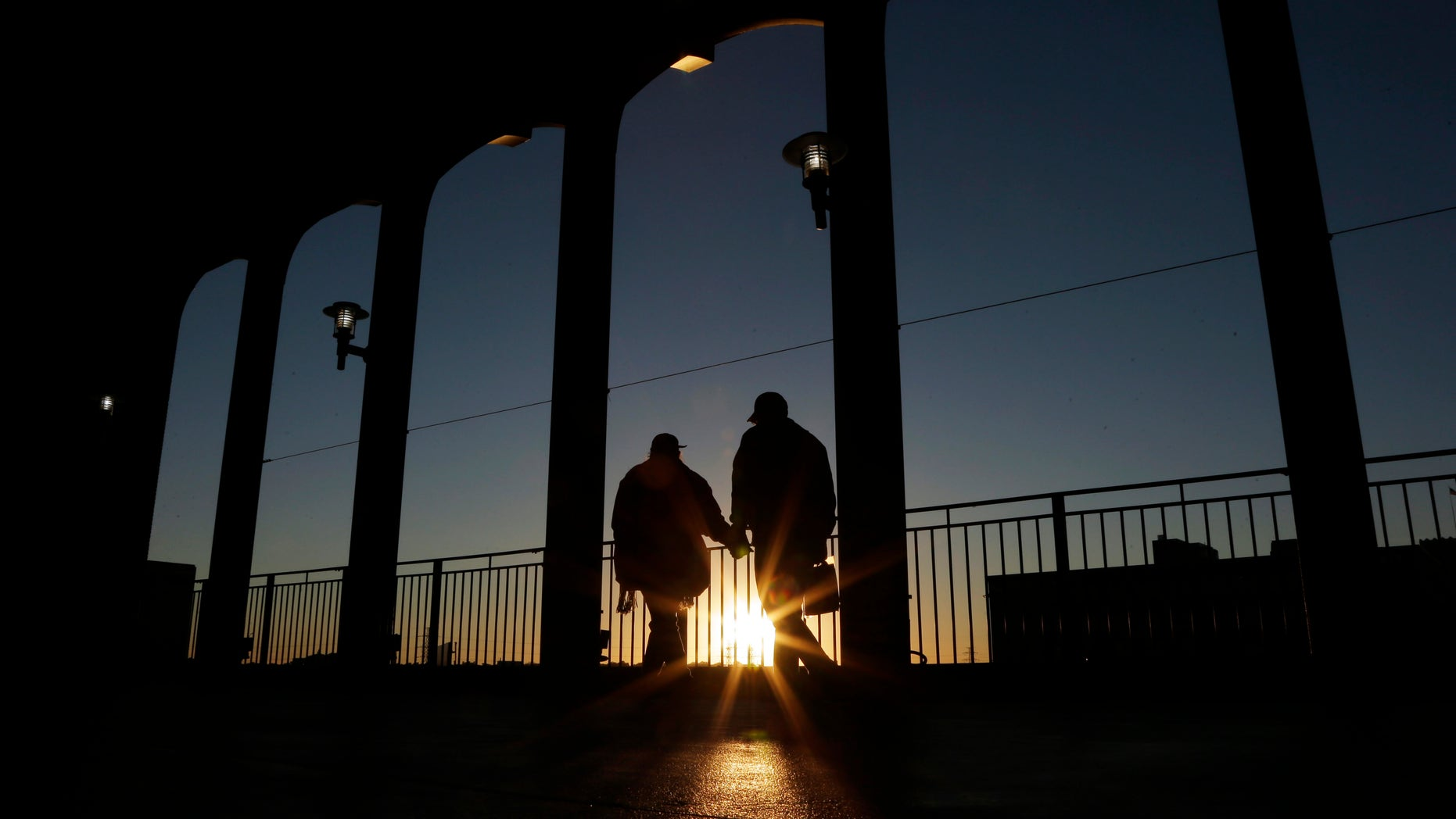 Baseball fans arrive at Busch Stadium for Stadium Game 4 of baseball's World Series between the St. Louis Cardinals and the Boston Red Sox, Sunday, Oct. 27, 2013, in St. Louis. (AP Photo/Charlie Riedel)