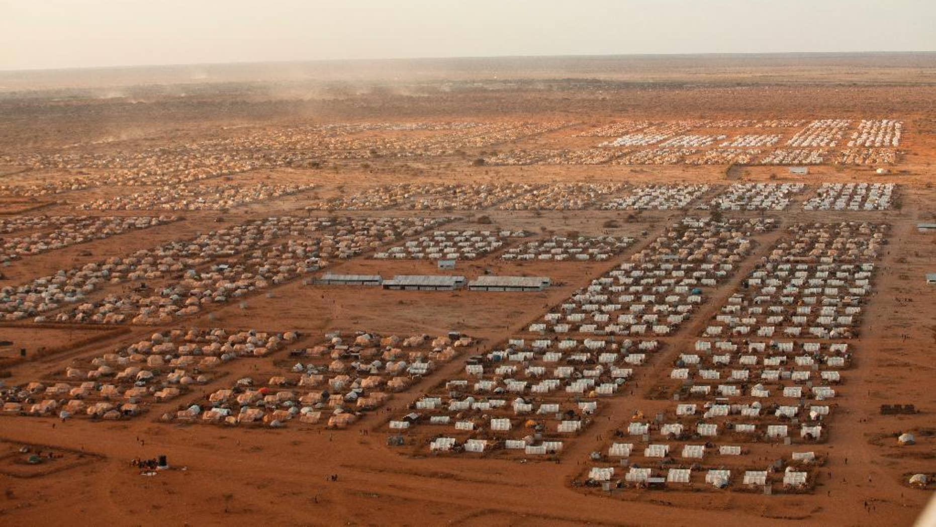 """This undated photo provided by MoMA shows IFO 3, an extension to the world's largest refugee camp complex in Dadaab, Kenya. The photograph is part of the exhibit """"Insecurities: Tracing Displacement and Shelter,"""" at the museum in New York. The new exhibit invites visitors to take an entirely new look at the concept of home and design, this time through the lens of migration and global refugee emergencies, in which temporary shelters, organizers say, are being deployed on a scale akin to that after World War I. (Brendan Bannon/IOOM/UNHCR/MoMA via AP)"""
