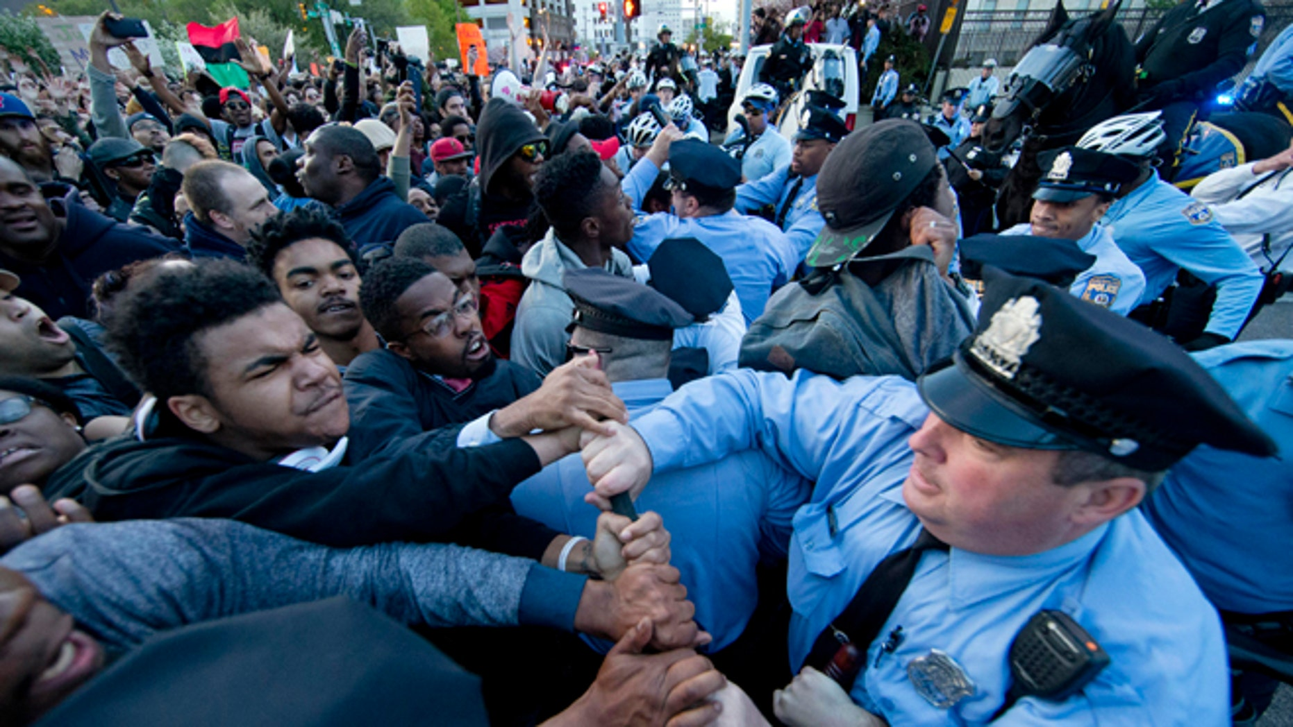 Protesters rush a police line after a rally at City Hall in Philadelphia on Thursday, April 30, 2015. The event in Philadelphia follows days of unrest in Baltimore amid Freddie Gray's police-custody death. (AP Photo/Matt Rourke)