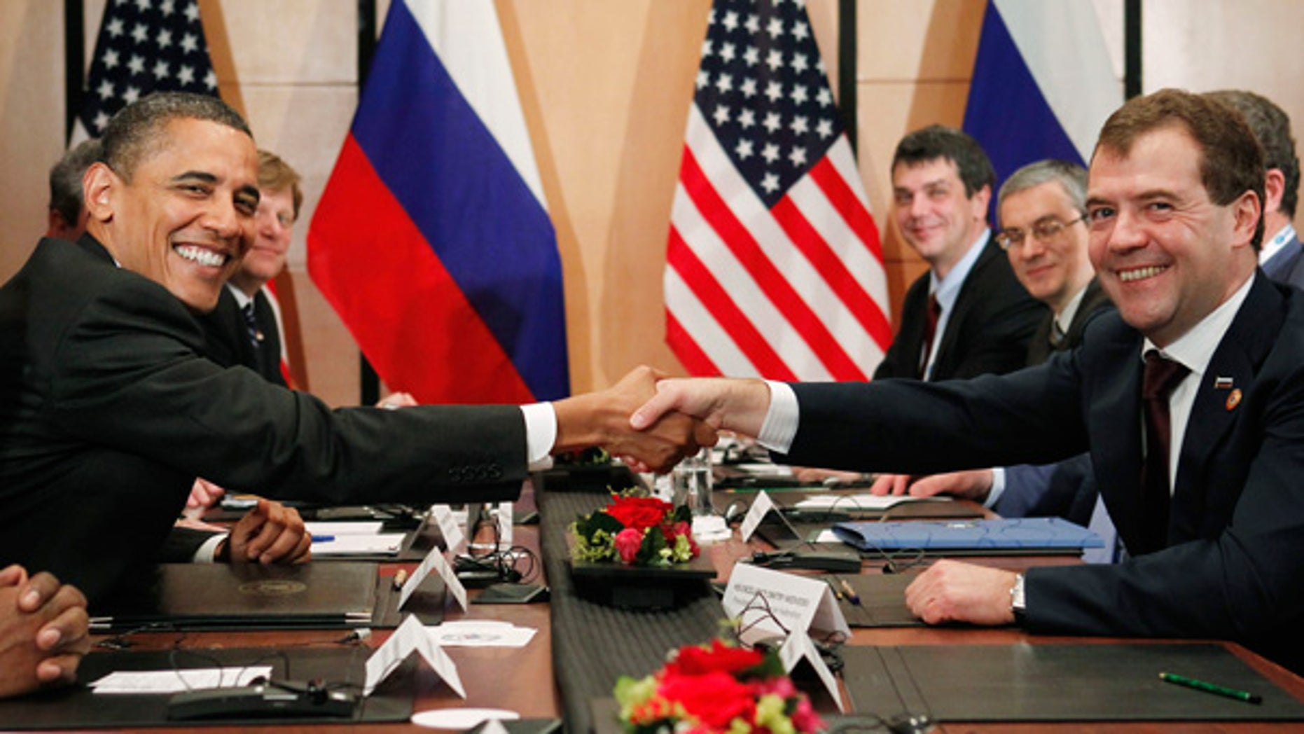 Nov. 14: President Obama shakes hands with President Dmitry Medvedev of Russia on the sidelines of the APEC summit in Yokohama, Japan.
