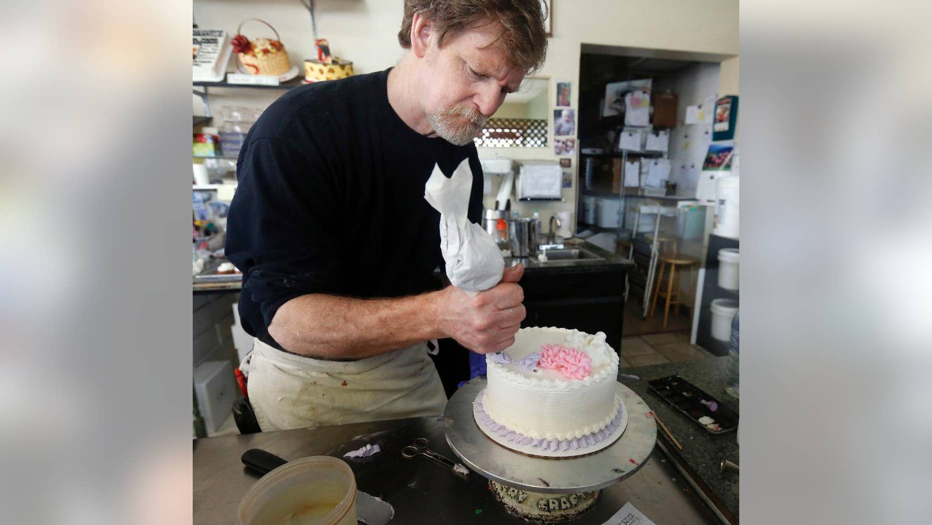In this March 10, 2014, file photo, Masterpiece Cakeshop owner Jack Phillips decorates a cake inside his store in Lakewood, Colo. Colorado's Supreme Court has refused to take up the case of Phillips, who would not make a wedding cake for a same-sex couple. (AP Photo/Brennan Linsley, File)