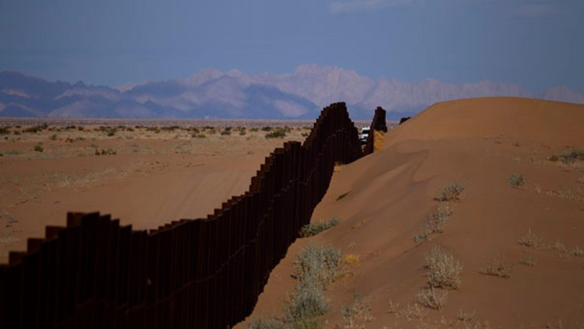 July 28: A US border patrol vehicle drives along the U.S.-Mexico border fence near Yuma, Arizona.