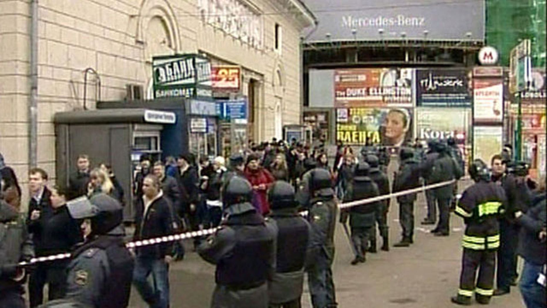Police outside Park Kultury subway station after bomb blast, Moscow, Russia.