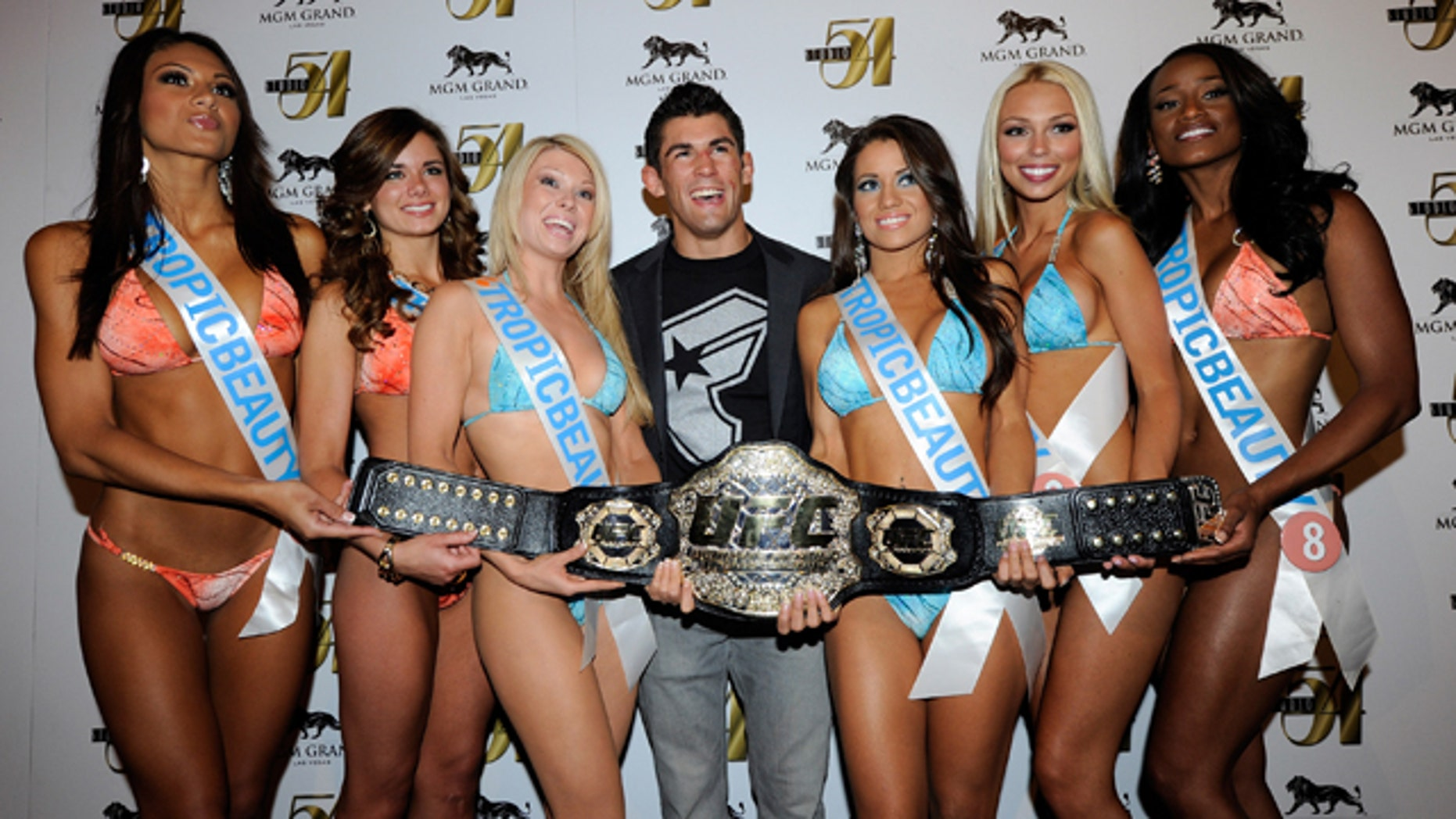 File Photo: Mixed martial artist Dominick Cruz (C) and Tropic Beauty Model Search contestants arrive at a post-fight party for UFC 132 at Studio 54 inside the MGM Grand Hotel/Casino early July 3, 2011 in Las Vegas, Nevada.  (Photo by Ethan Miller/Getty Images for Studio 54)
