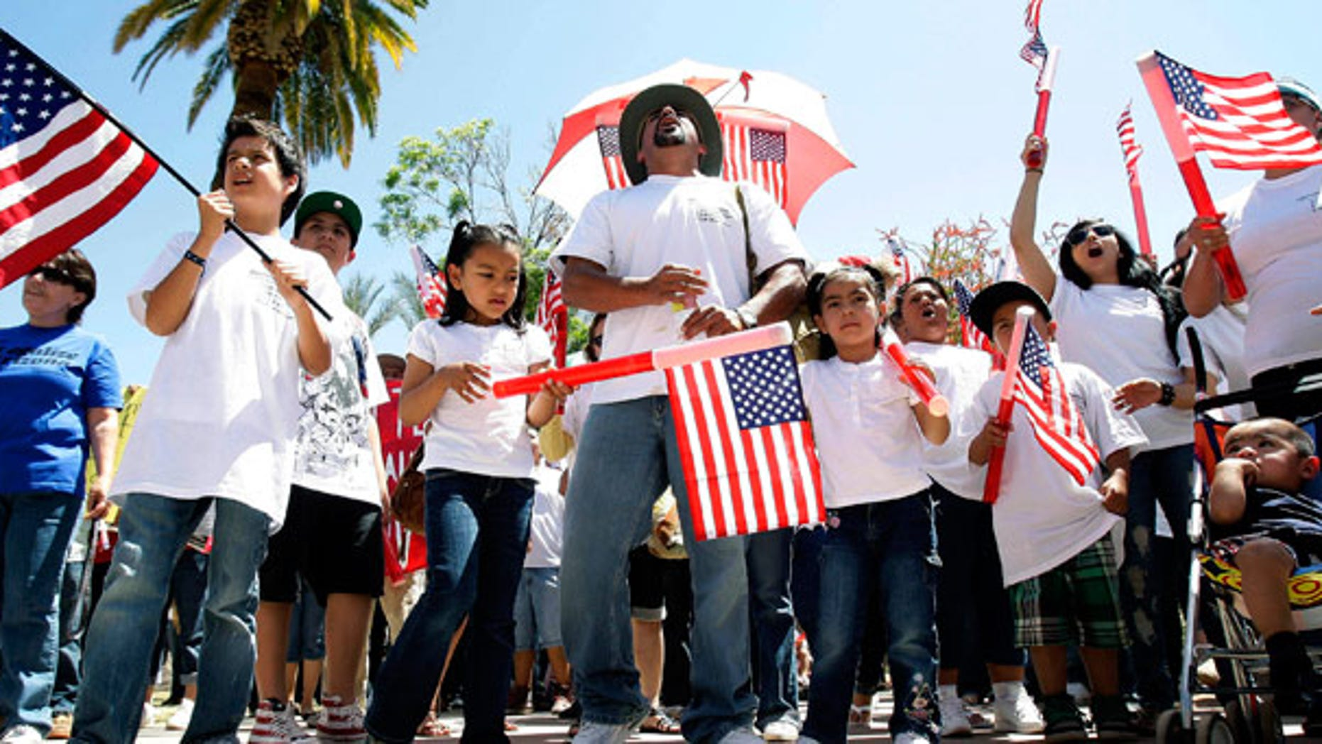 April 25: Thousands of protesters rally at the Arizona Capitol to fight a tough new state law targeting illegal immigrants.