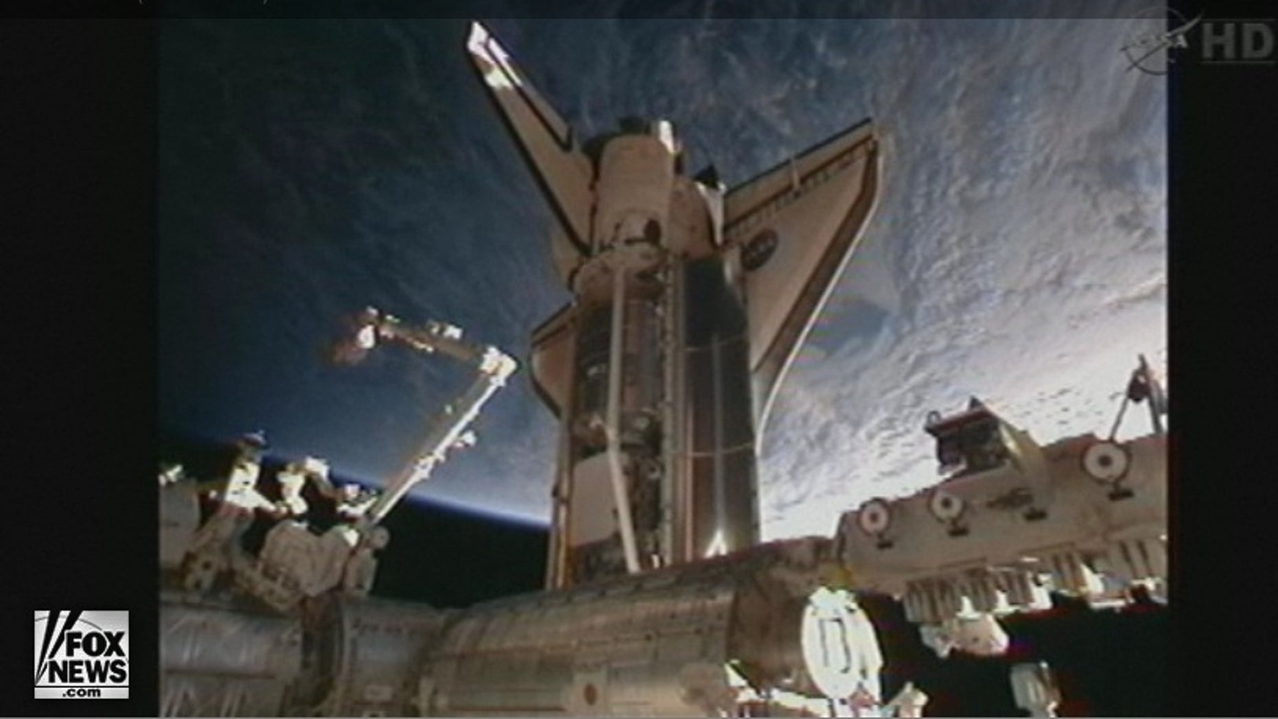 Space shuttle Discovery docked with the International Space Station at 2:14 p.m. EST Saturday.