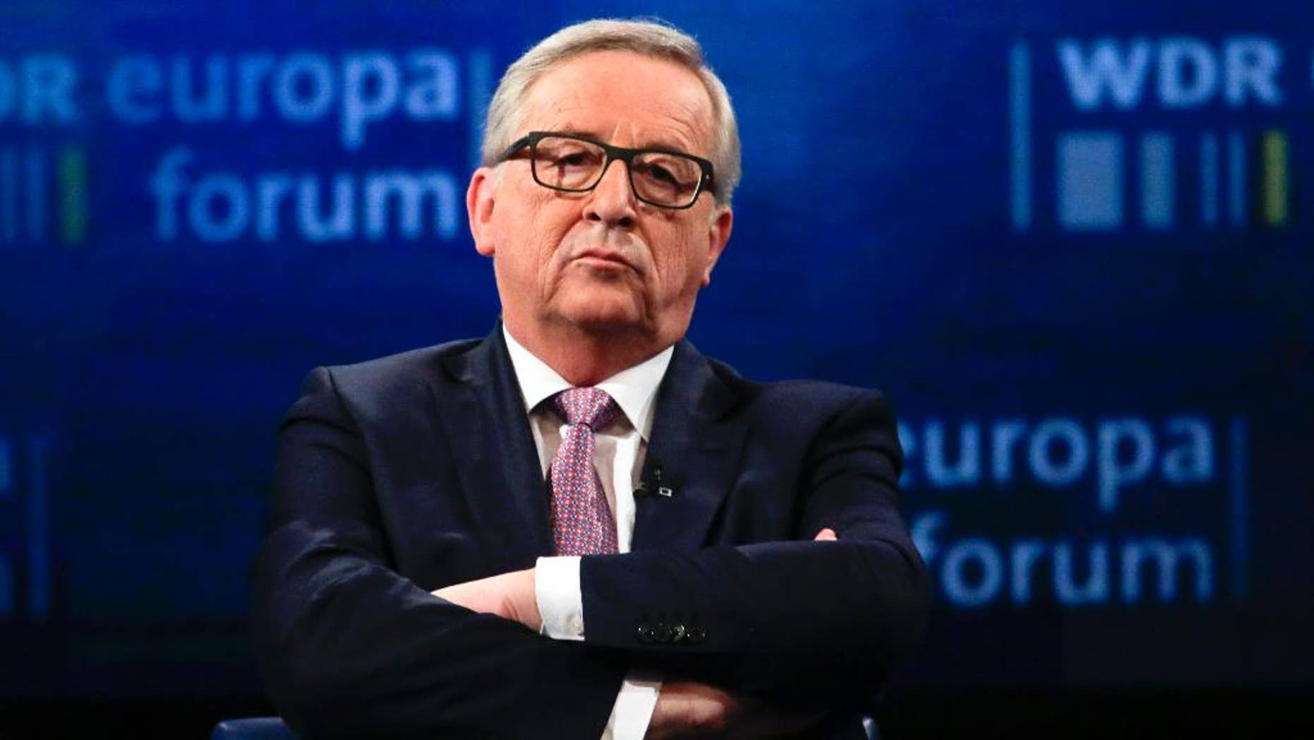 CORRECTS SPELLING OF JUNCKER- The President on the European Commission Jean-Claude Juncker attends a panel discussion about the future of Europe at the Europe Forum event, hosted by the Germany's WDR television and broadcast service, at the Foreign Ministry, in Berlin, Germany, Thursday, May 12, 2016. (AP Photo/Markus Schreiber)