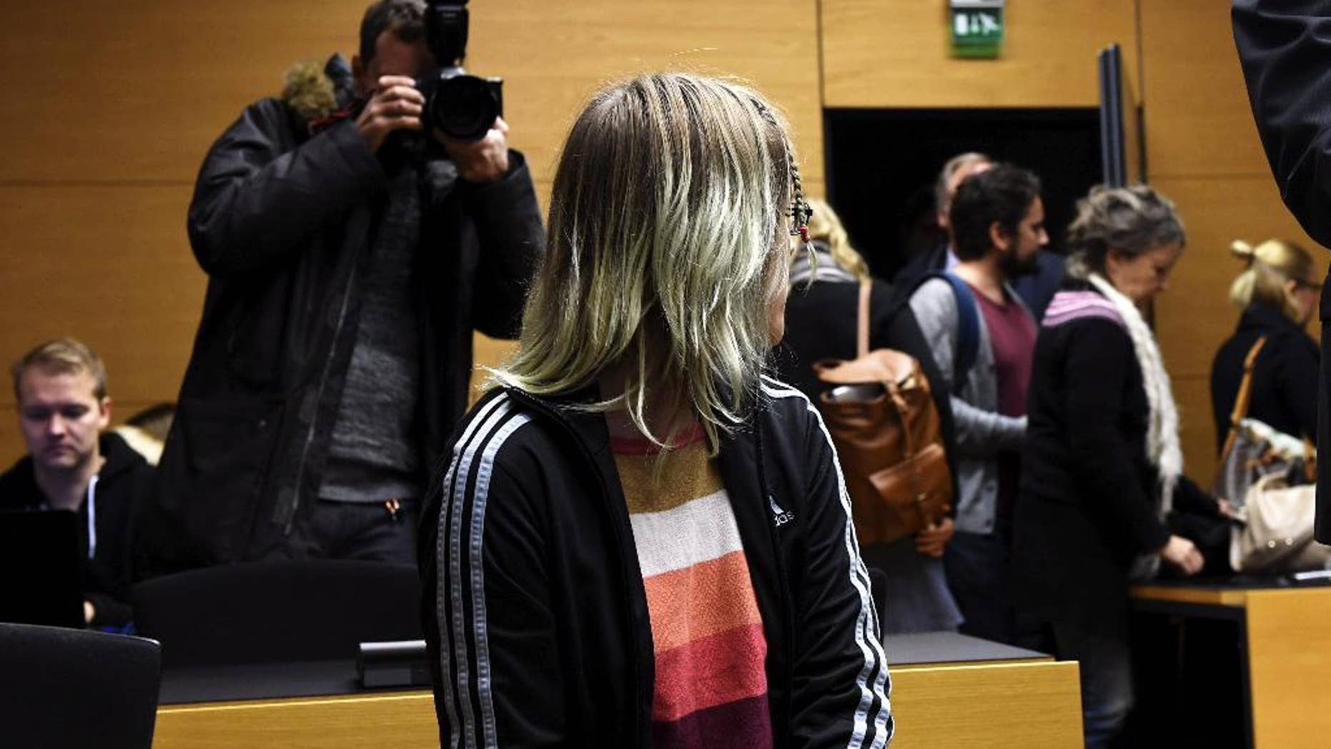 An unidentified 21-year-old Finnish woman is pictured at the Helsinki District Court on Friday Nov. 11, 2016. Prosecutors said the woman a former student was planning a school shooting in central Finland that would kill at least 40 students.(Vesa Moilanen, Lehtikuva via AP)