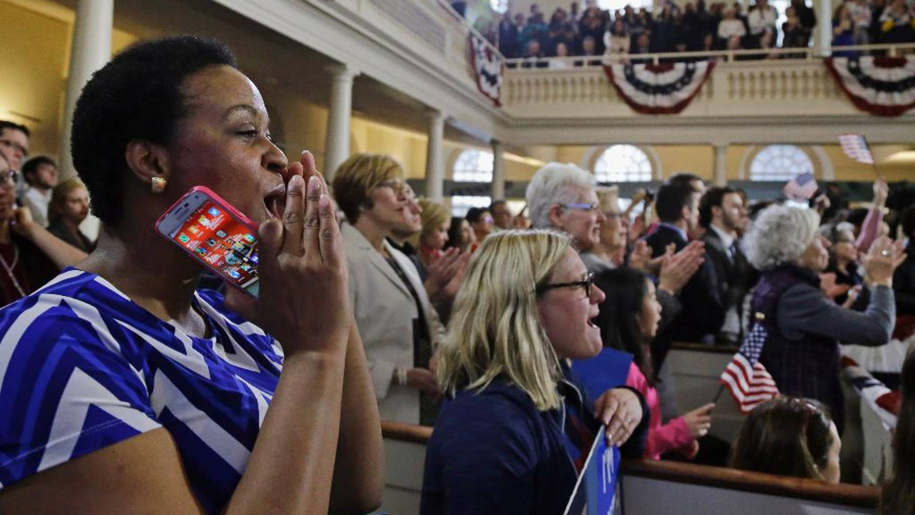 FILE- In this Feb. 29, 2016, file photo, supporters cheer Democratic presidential candidate Hillary Clinton as she speaks during a campaign event at the Old South Meeting House in Boston. The meeting house where colonists gathered to begin challenging British rule before the American Revolution and launched the Boston Tea Party has reopened. (AP Photo/Elise Amendola, File)