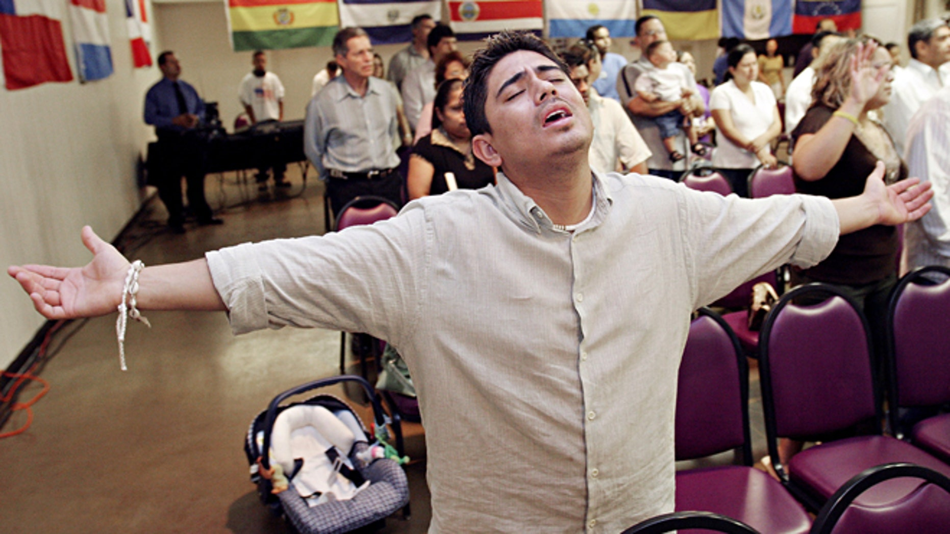 MESA, AZ - APRIL 9:  Charlie Anaya, of Phoenix, prays during the worship service at Iglesia Palabra de Vida April 9, 2006 in Mesa, Arizona. There are approximately 300 evangelical Hispanic churches with 15,000 members in the Phoenix area that have been instrumental in organizing for immigrants rights.  (Photo by Jeff Topping/Getty Images)