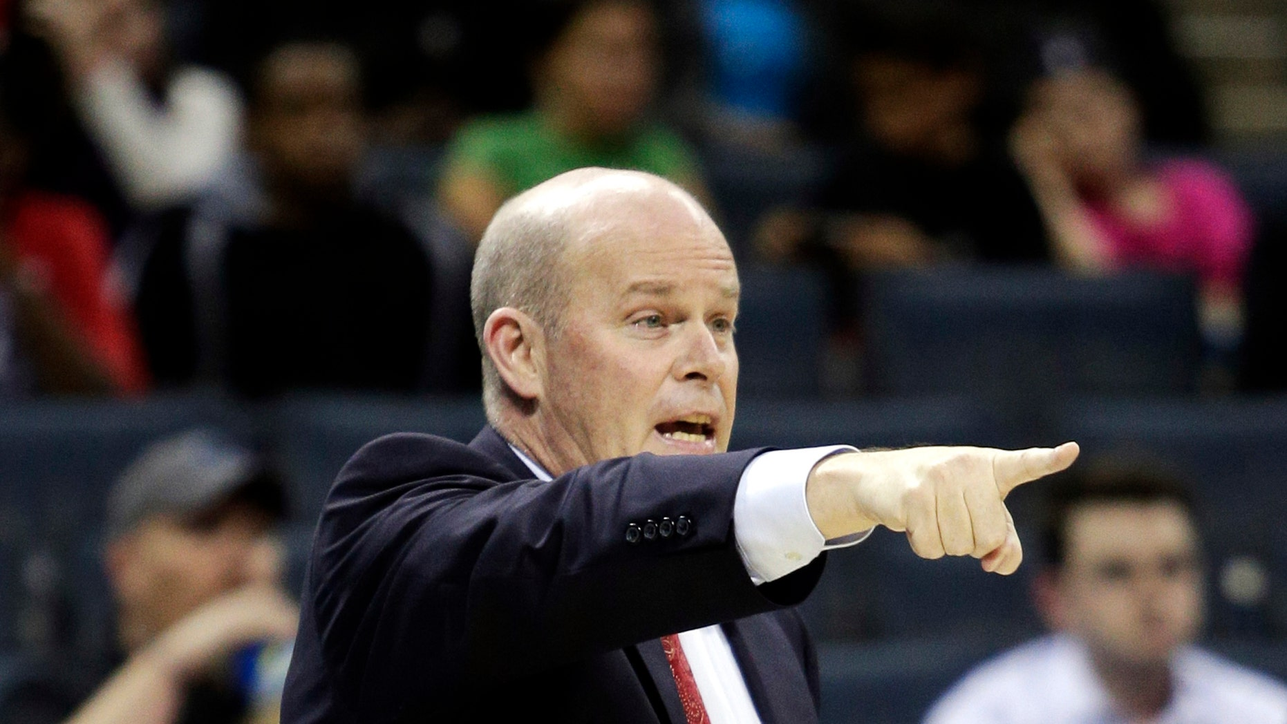 Charlotte Bobcats coach Steve Clifford directs his team as they play the Toronto Raptors in the second half of an NBA basketball game in Charlotte, N.C., Wednesday, Nov. 6, 2013. Charlotte won 92-90. (AP Photo/Nell Redmond)