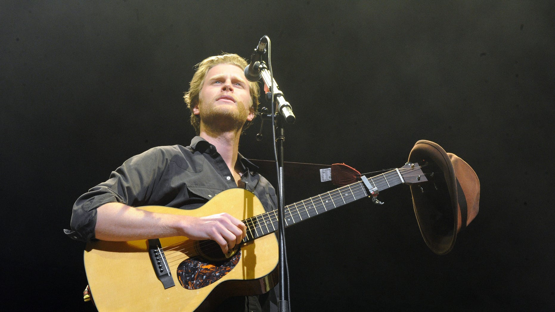 "FILE - In this Dec. 8, 2012 file photo, Wesley Schultz of The Lumineers performs at KROQ Almost Acoustic Christmas in Los Angeles. The Lumineers' ""Ho Hey"" was the top streamed track on Spotify for the week of Dec. 10. (Photo by Katy Winn/Invision/AP, File)"