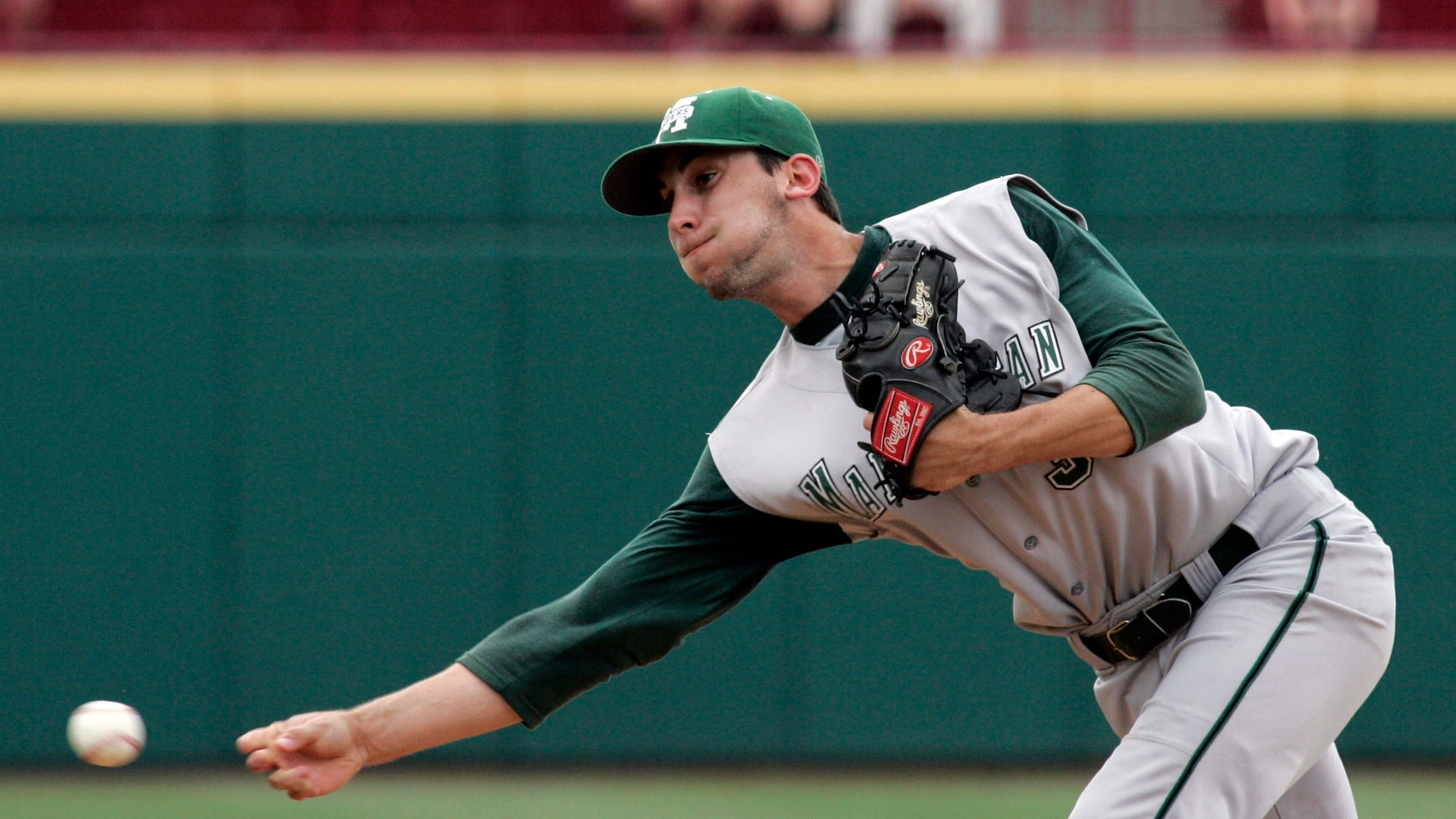 FILE - In this June 1, 2012, file photo, Manhattan's Taylor Sewitt delivers his pitch during an NCAA college baseball game against South Carolina in Columbia, S.C. Sewitt's deceptive submarine-style delivery helped him rack up 22 scoreless innings for Manhattan College in the MAAC tournament last May, winning three games in four days and tossing 296 pitches. (AP Photo/Mary Ann Chastain, File)