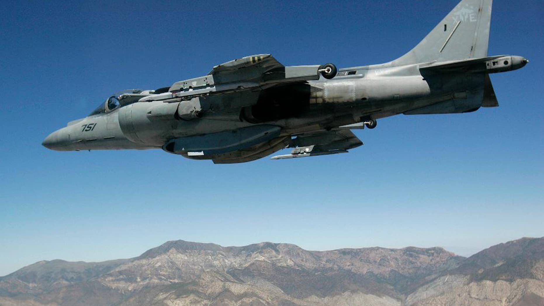 FILE - In this June 21, 2007 file photo, a U.S. Marine Corps AV-8 Harrier fighter jet from VX-9 Naval Air Weapons Station China Lake is seen on a training flight from the cockpit of an F-16 based at the California Air National Guard's 144th Fighter Wing over California. A U.S. Marine Corps AV-8 Harrier fighter jet, the same type shown in this photo, crashed Thursday, Sept. 22, 2016, into the ocean off the coast of southwestern Okinawa in Japan, but the pilot ejected safely from the aircraft and was rescued. The U.S. military in Camp Butler in Okinawa said the cause of the crash is still under investigation. (AP Photo/Ben Margot, File)