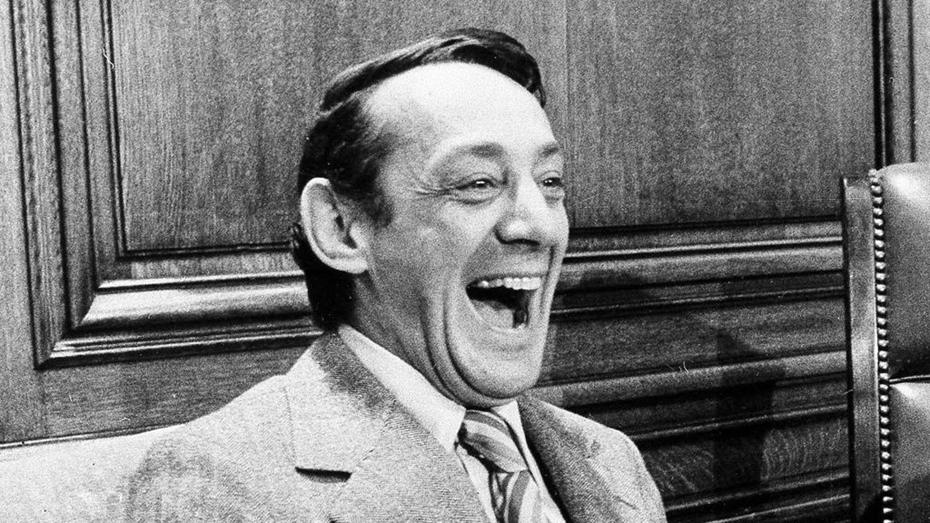 FILE - In this April 1977 file photo, San Francisco supervisor Harvey Milk sits in the mayor's office during the signing of the city's gay rights bill in San Francisco. The late gay rights leader Milk already has schools, streets and parks named in his honor. Soon, a U.S. Navy ship will join the list. A Navy official said Friday, July 29, 2016, that Navy Secretary Ray Mabus notified Congress earlier this month that a new fleet of replenishment oilers being built in San Diego will be named for Milk and five other civil and human rights icons. (AP Photo/File)
