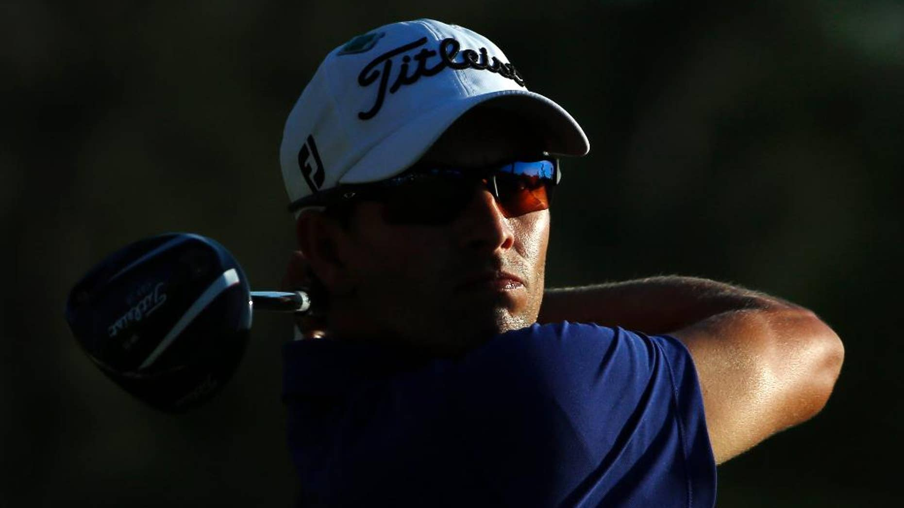 Adam Scott, of Australia, tees off during the third round of the Masters golf tournament Saturday, April 12, 2014, in Augusta, Ga. (AP Photo/David J. Phillip)