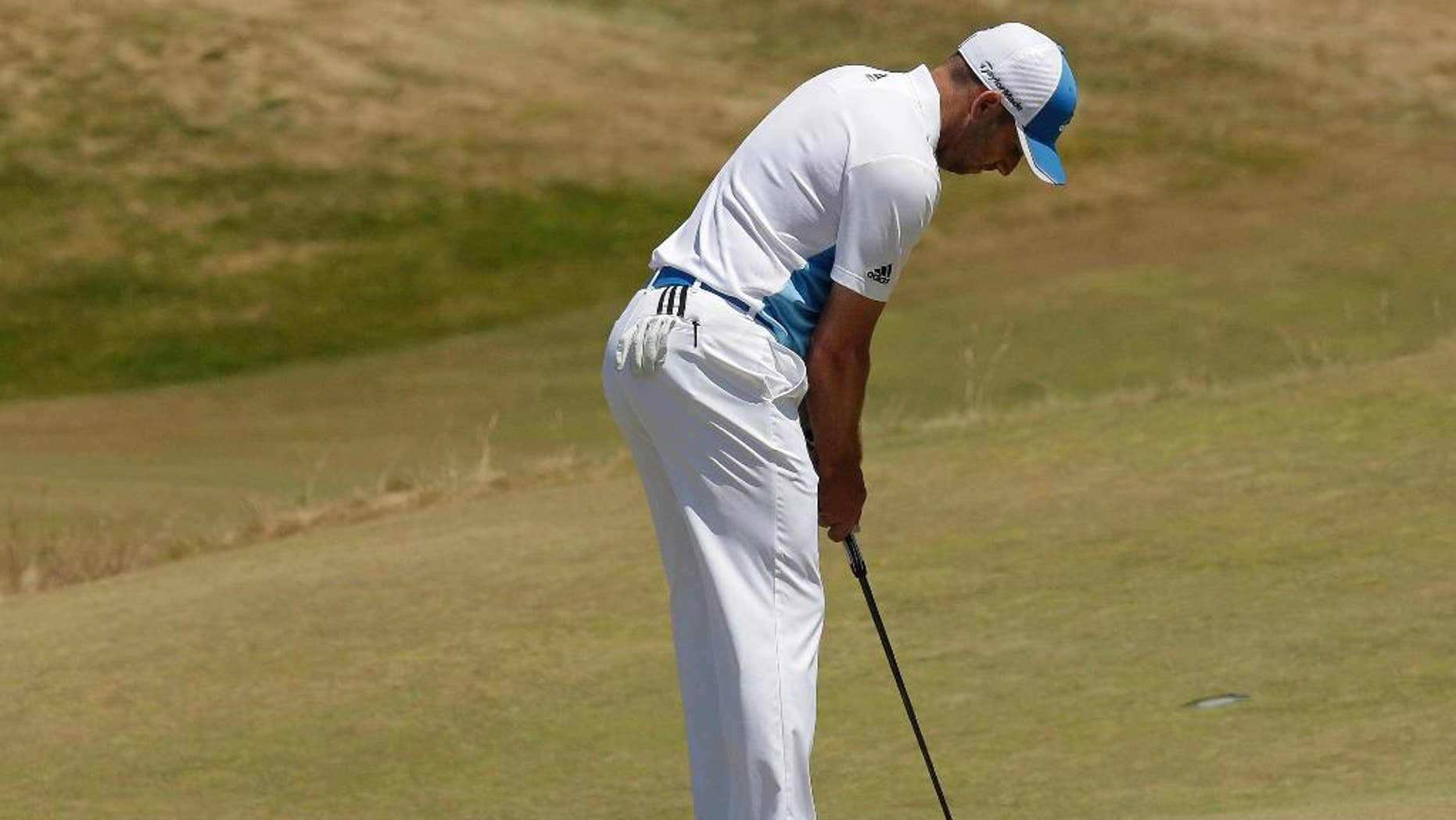 Sergio Garcia, of Spain, putts on the 17th hole during a practice round for the U.S. Open golf tournament at Chambers Bay on Wednesday, June 17, 2015 in University Place, Wash. (AP Photo/Charlie Riedel)