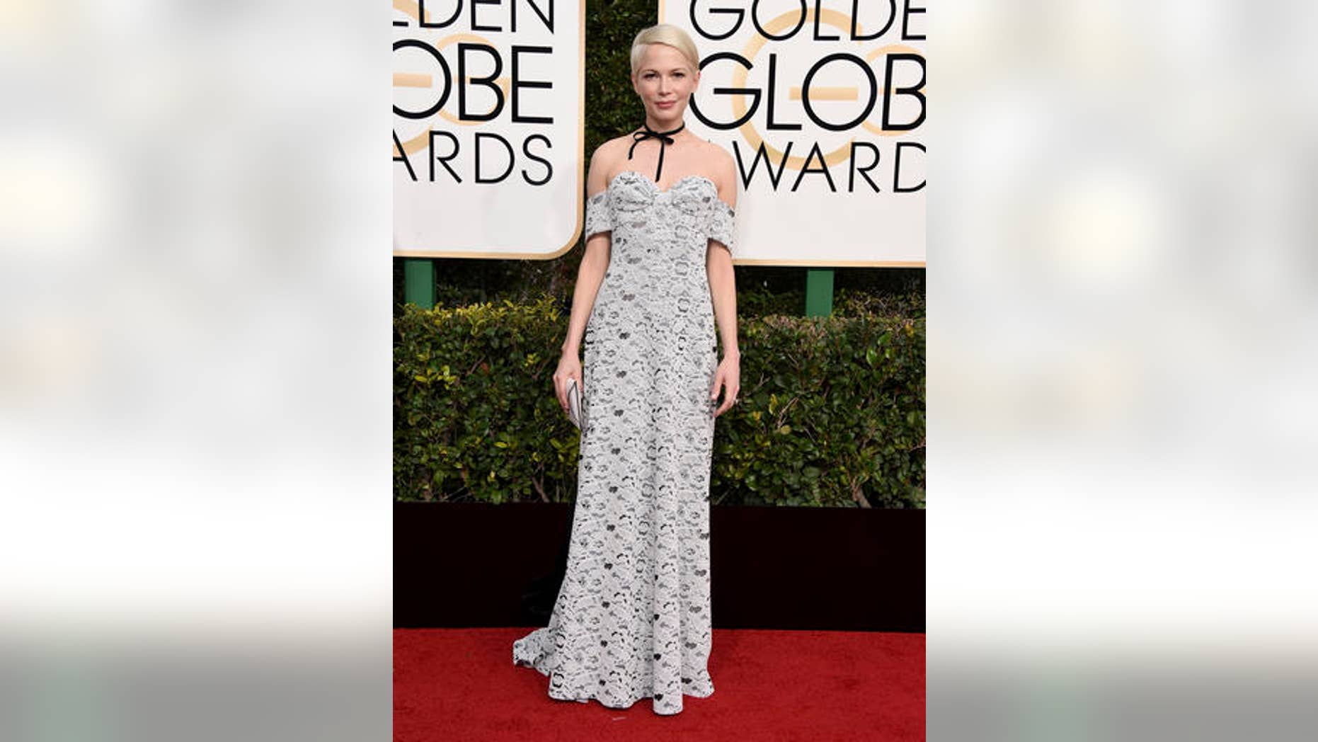 Michelle Williams usually stuns on the red carpet, but at tonight's Globes she missed the mark in this white crocheted number and black bow choker.