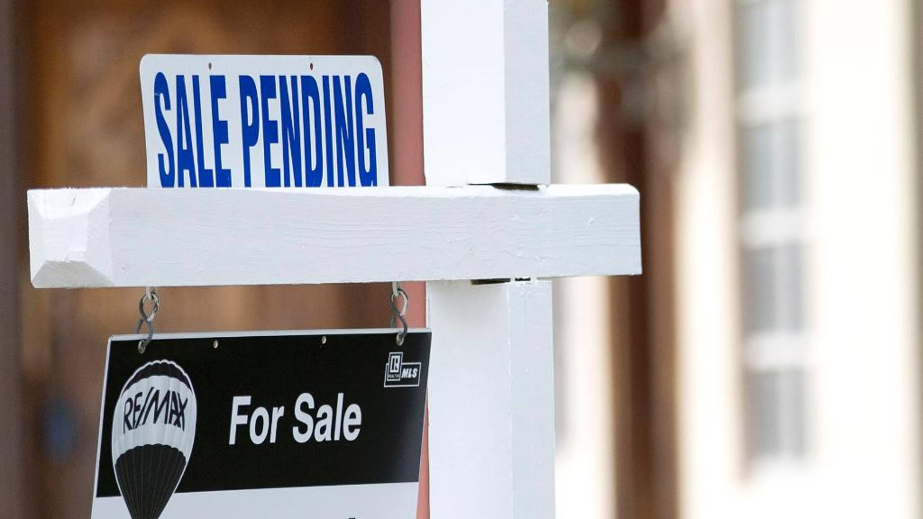 """FILE - In this Thursday, Jan. 8, 2015, file photo, a """"sale pending"""" sits atop a realty sign outside a home for sale in Surfside, Fla. The National Association of Realtors releases its pending home sales index for June on Wednesday, July 29, 2015. (AP Photo/Wilfredo Lee, File)"""