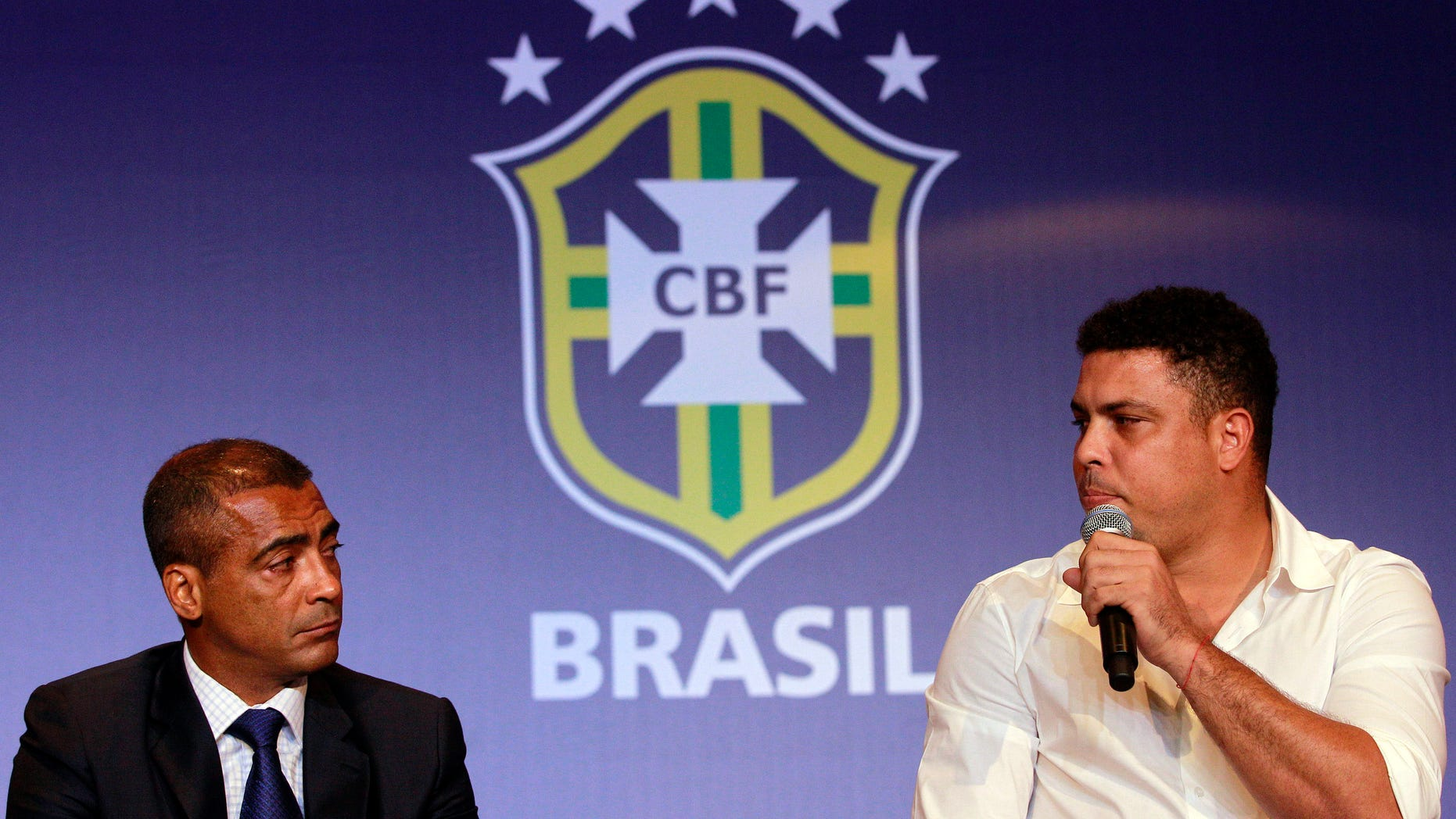 FILE - In this Dec. 23, 2011 file photo, former soccer stars Romario, left, and Ronaldo give a news conference in Rio de Janeiro, Brazil.  Romario and Ronaldo are at odds over the World Cup in Brazil, criticizing each other's conflicting comments about what the tournament means to the country's population. (AP Photo/Victor R. Caivano, File)