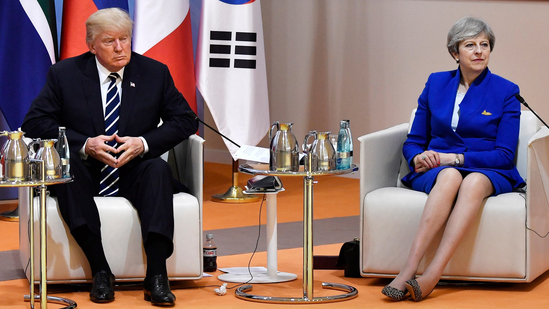 """US President Donald Trump and Britain's Prime Minister Theresa May sit at the start of the """"retreat meeting"""" on the first day of the G-20 summit in Hamburg, northern Germany, on Friday July 7, 2017 . Leaders of the world's top economies will gather from July 7 to 8, 2017.  (John MacDougall/Pool Photo via AP)"""