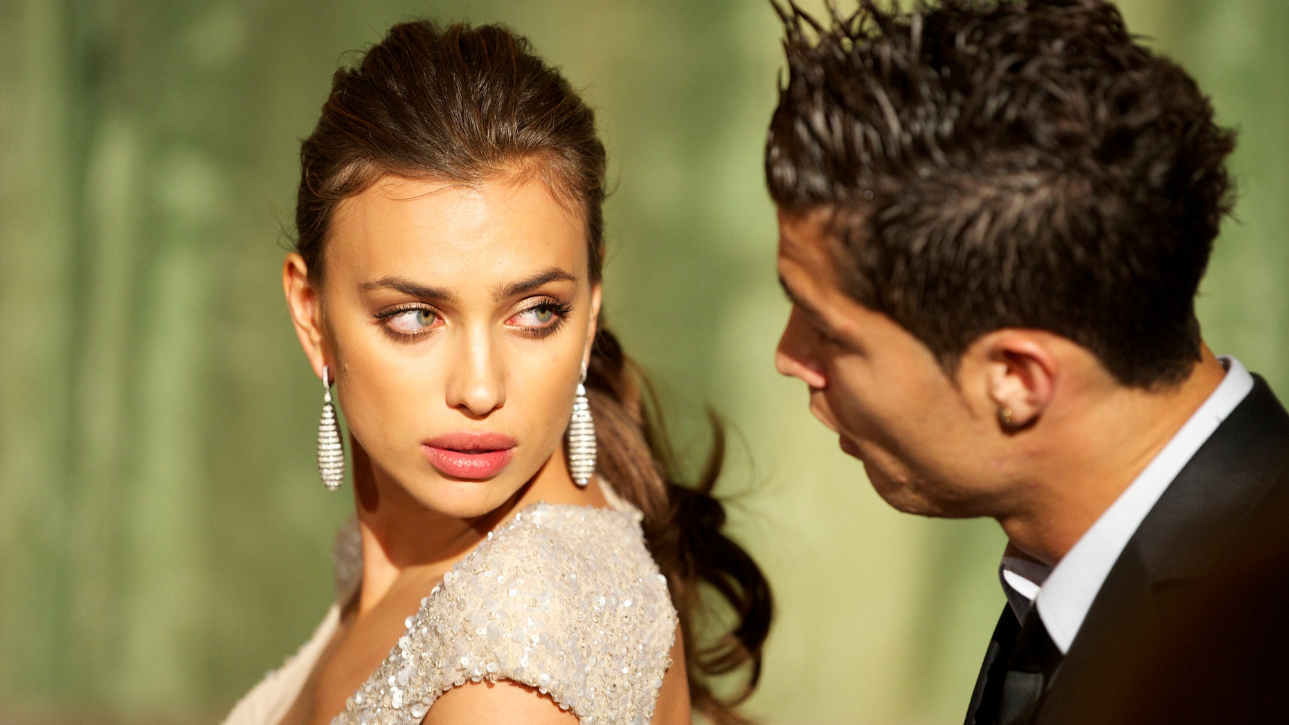 MADRID, SPAIN - NOVEMBER 17:  Model Irina Shayk and Real Madrid player Cristiano Ronaldo attend Marie Claire Prix de la Moda awards 2011 at French Embassy on November 17, 2011 in Madrid, Spain.  (Photo by Carlos Alvarez/Getty Images)