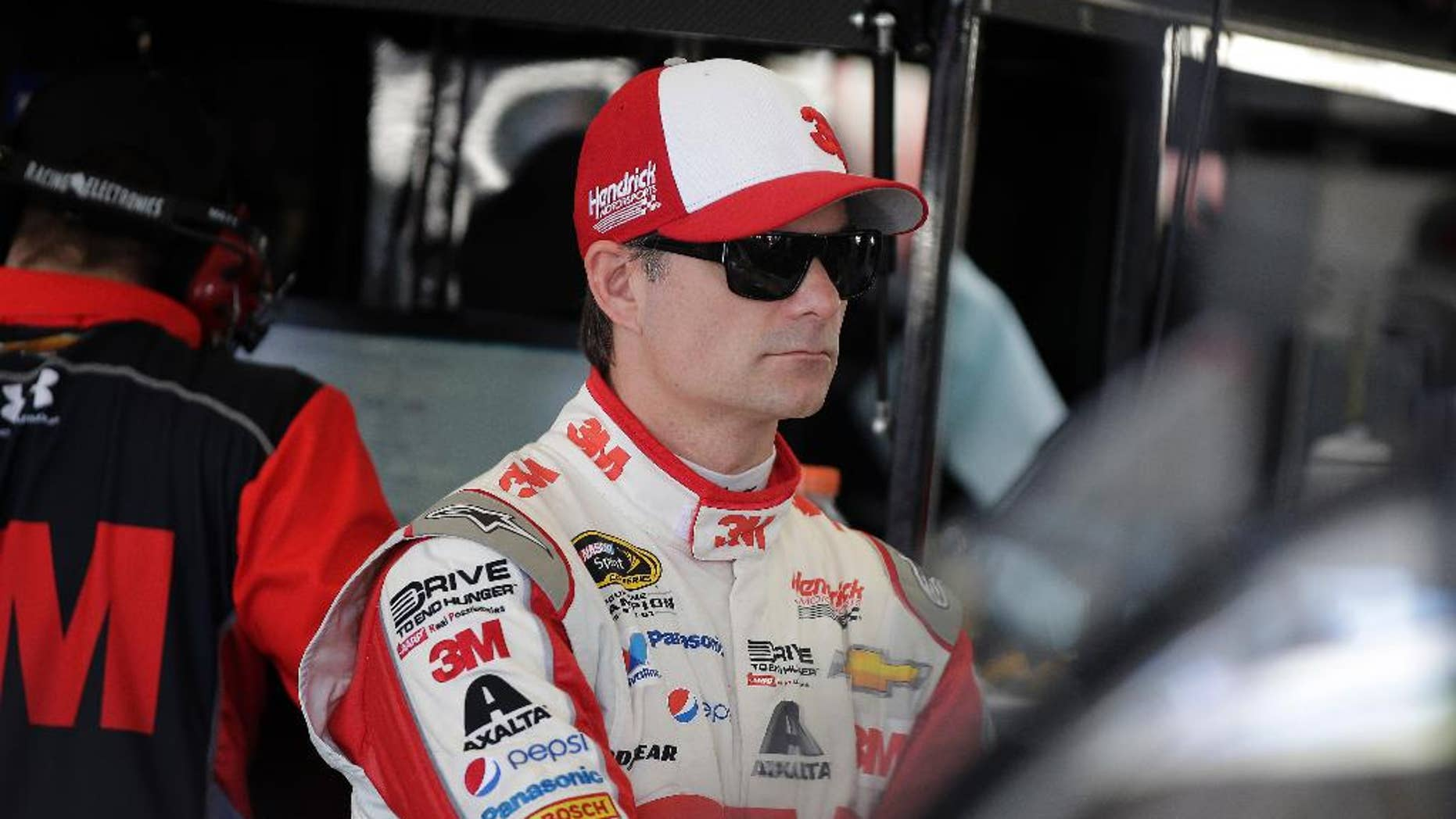 Jeff Gordon works in the garage during practice for Sunday's NASCAR Sprint Cup Series auto race Friday, March 6, 2015, in Las Vegas. Gordon went on to win the pole position. (AP Photo/Isaac Brekken)