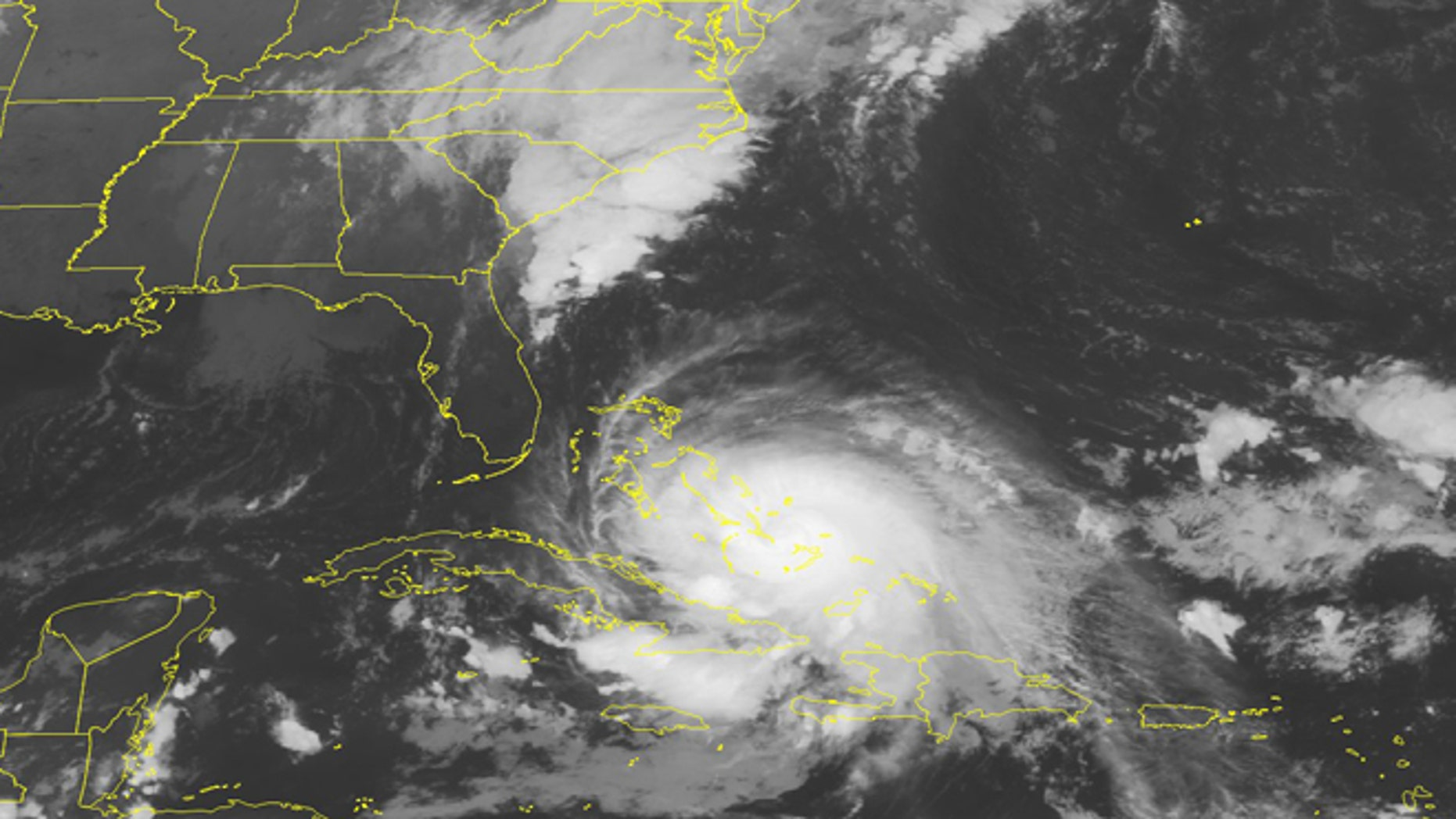 This NOAA satellite image taken Friday, Oct. 2, 2015 at 12:45 AM EDT shows a powerful Category 4 Hurricane Joaquin crawling through the Bahamas.  (Weather Underground via AP)