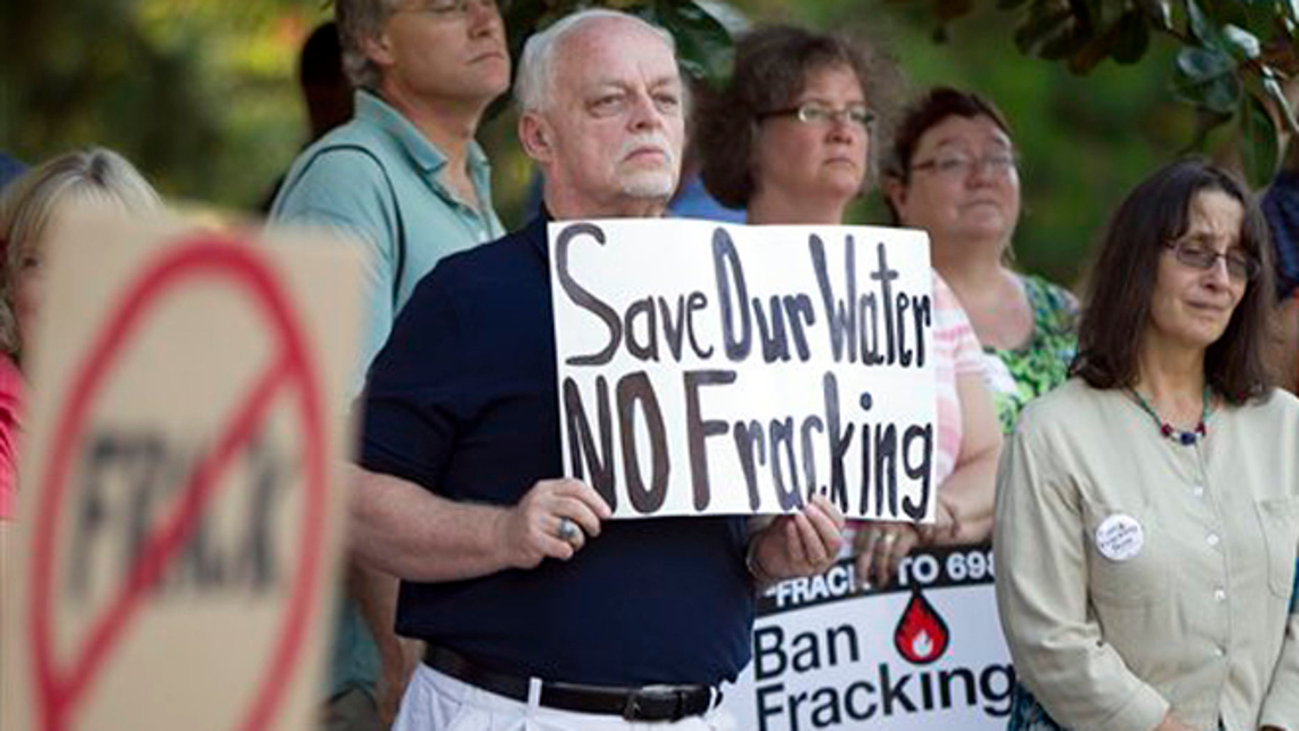 FILE: June 27, 2012: Wake County resident Marvin Woll joins others in Raleigh, N.C., to protest fracking in North Carolina.