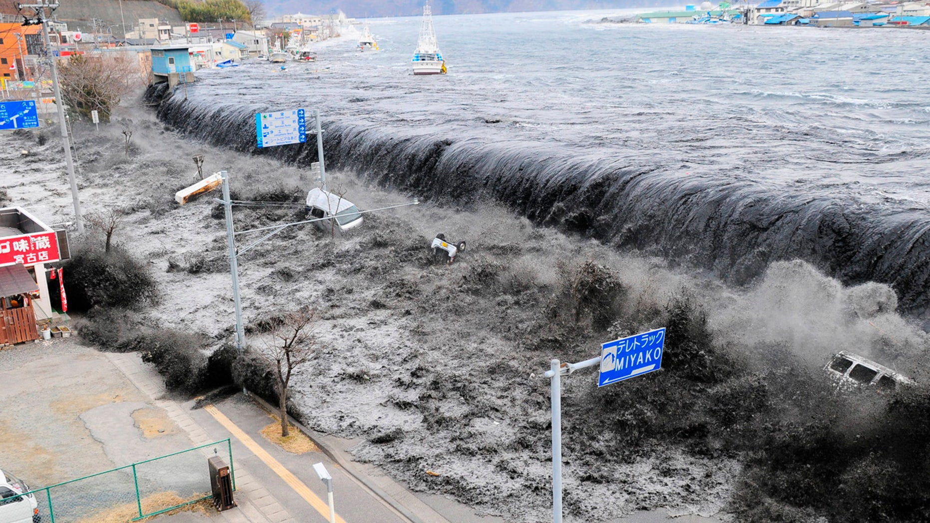 March 11, 2011: A wave approaches Miyako City from the Heigawa estuary in Iwate Prefecture after the magnitude 8.9 earthquake struck the area